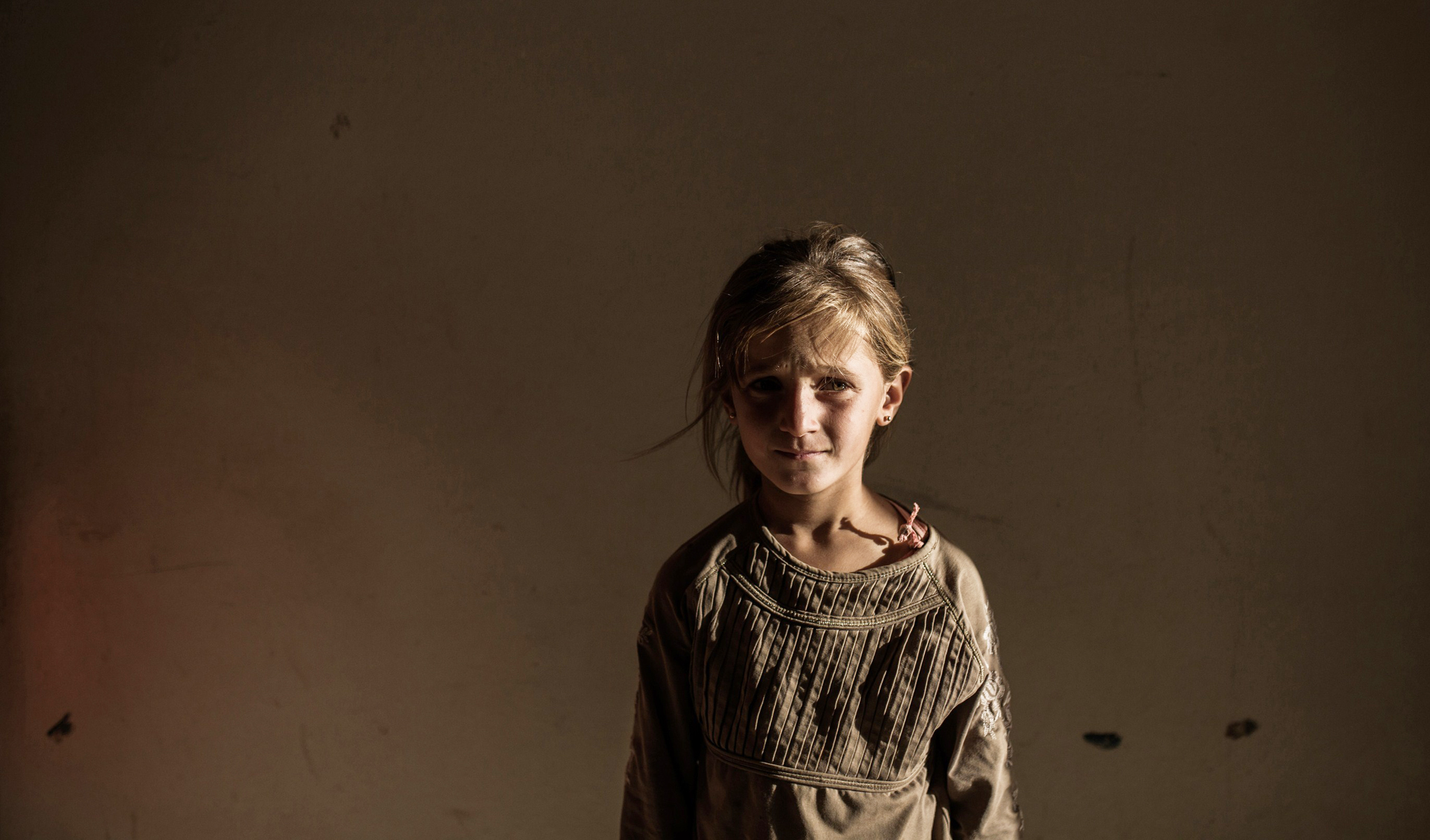 A Syrian refugee girl stands in a buildi...A Syrian refugee girl stands in a building on June 27, 2015 in Syrian Kurdish city of Amuda, after running away from clashes between regime forces and the Islamic State group.  AFP PHOTO/UYGAR ONDER SIMSEKUYGAR ONDER SIMSEK/AFP/Getty Images