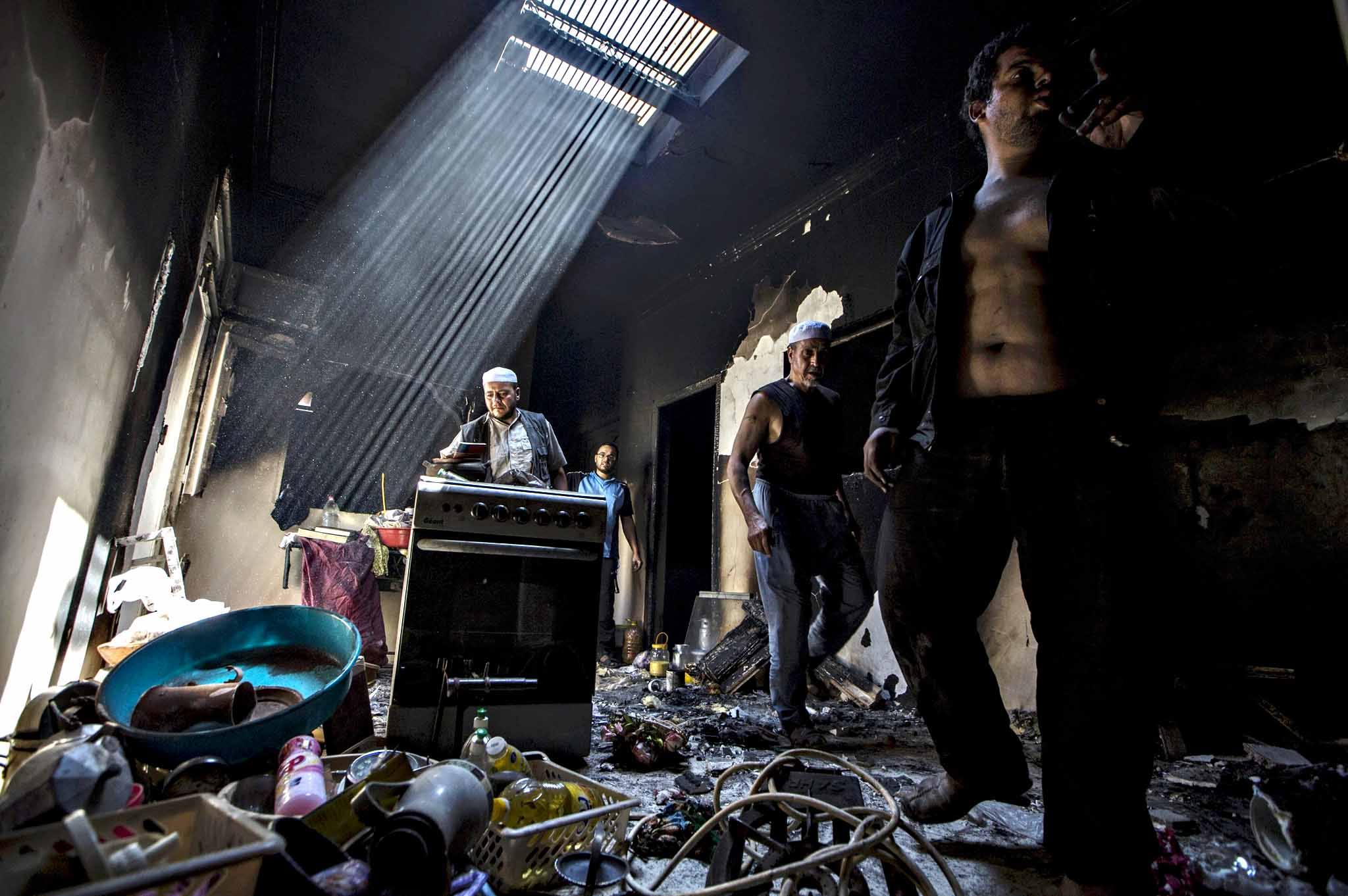 Mozabite Berbers salvage their belongings at a damaged house after clashes between Arabs and Mozabits in Guerrara near Ghardaia, Algeria July 9, 2015. At least 22 people have been killed in ethnic clashes between Arab and Amazigh communities around the Algerian desert town of Ghardaia, with several businesses and homes burned down, medical sources and state media said on Wednesday. The violence that erupted over the weekend was some of the worst in years in the flashpoint region where tensions often run high between Arabs and Mozabite Berbers - one of the Amazigh people of North Africa - competing for jobs, houses and land