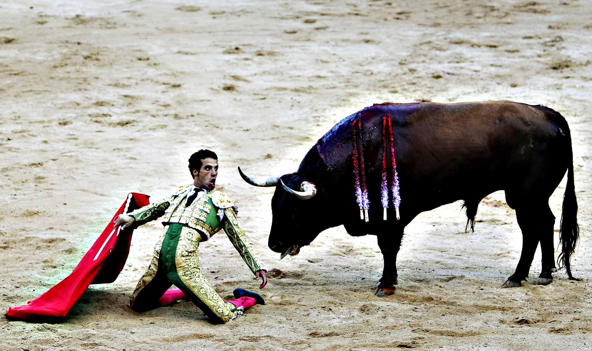 "Spain's bullfighter Jesus Martinez ""Morenito de Aranda"" performs a pass during a bullfight at the San Fermin Festival in Pamplona, Spain"