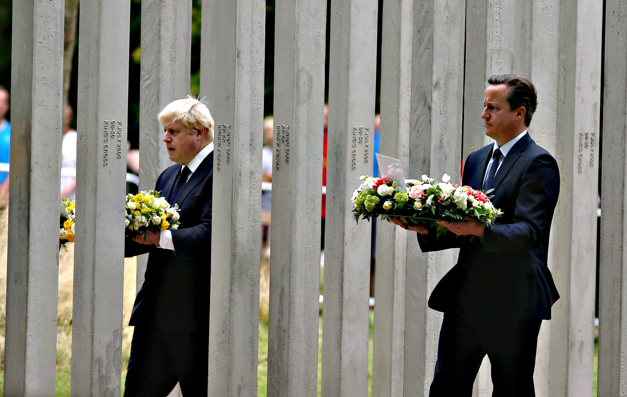 British Prime Minister David Cameron (R) and London Mayor Boris Johnson during a ceremony at the memorial to the victims of the July 7, 2005 London bombings, in Hyde Park on July 7, 2015 in London, England. Today is the tenth anniversary of the 7/7 bombings, when four suicide bombers struck transport system in central London on Thursday 7 July 2005, killing 52 people and injuring more than 770 in simultaneous attacks