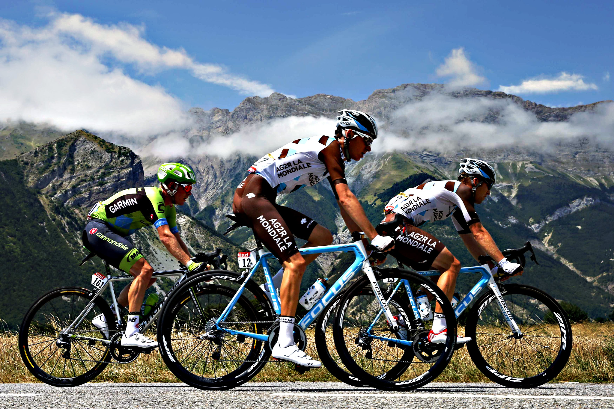 Cannondale-Garmin rider Talansky of the US, AG2R La Mondiale riders Bardet of France and Bakelants of Belgium cycle during the 18th stage of the 102nd Tour de France cycling race...Cannondale-Garmin rider Andrew Talansky of the U.S. (L), AG2R La Mondiale riders Romain Bardet of France (C) and Jan Bakelants of Belgium cycle during the 186.5-km (115.88 miles) 18th stage of the 102nd Tour de France cycling race from Gap to Saint-Jean-de-Maurienne in the French Alps mountains, France, July 23, 2015.