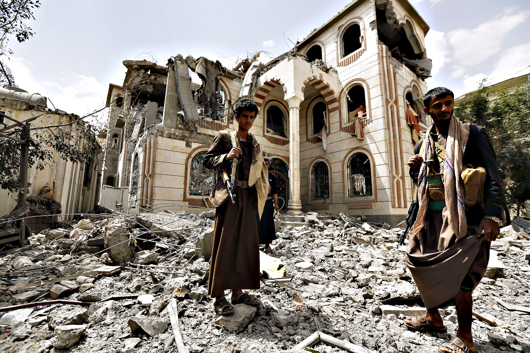 Guards stand on the rubble of the house of Brigadier Khaled al-Anduli, an army commander loyal to the Houthi movement, after it was hit by Saudi-led air strikes in Yemen's capital Sanaa...Guards stand on the rubble of the house of Brigadier Khaled al-Anduli, an army commander loyal to the Houthi movement, after it was hit by Saudi-led air strikes in Yemen's capital Sanaa July 6, 2015. Yemen's exiled government said on Monday it expects a deal shortly on a humanitarian ceasefire that would run through the Muslim Eid al-Fitr holiday later this month, as the capital Sanaa came under renewed air strikes
