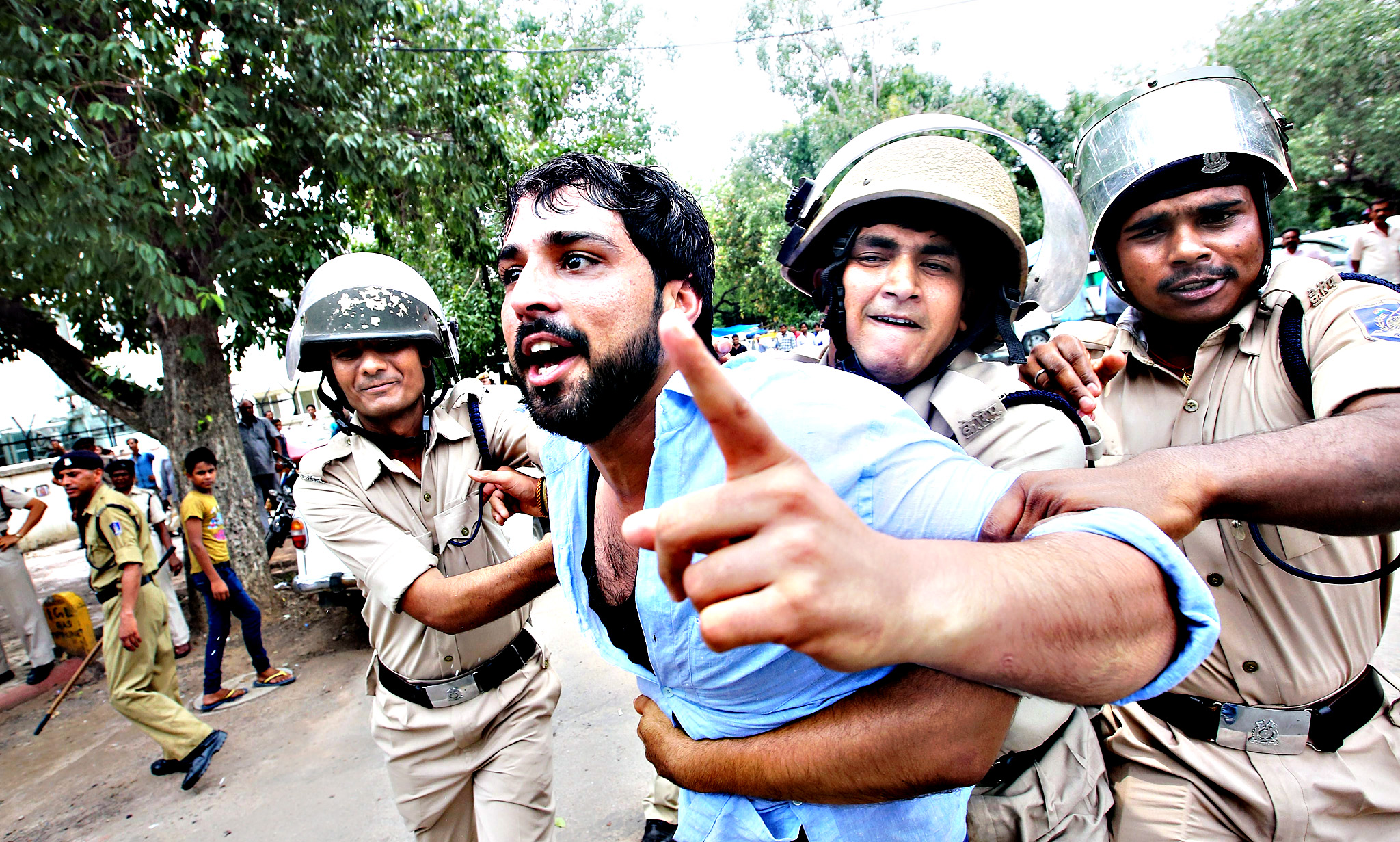 Indian police detain a Youth Congress activist after they storm a barricade during a protest against the Bhartiya Janta Party (BJP) led Government near parliament house in New Delhi, India, 22 July 2015. Members of Indian Youth Congress protested against the Ministers of BJP led Government for their alleged involvement in various scams including the recruitment racket in Vyapam or the Madhya Pradesh Professional Examination Board and helping former cricket official, Lalit Modi