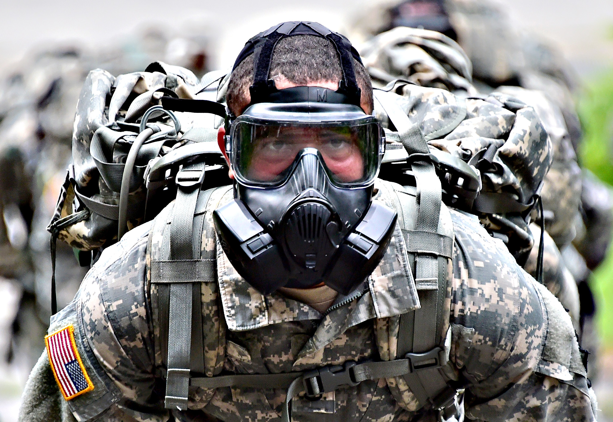 A US soldier wears a gas mask during a competition to test individual skills at a US Army base in Uijeongbu, north of Seoul, on July 8, 2015. The goal of the competition is to foster esprit de corps across the units participating and to continue to strengthen the US-South Korea alliance.