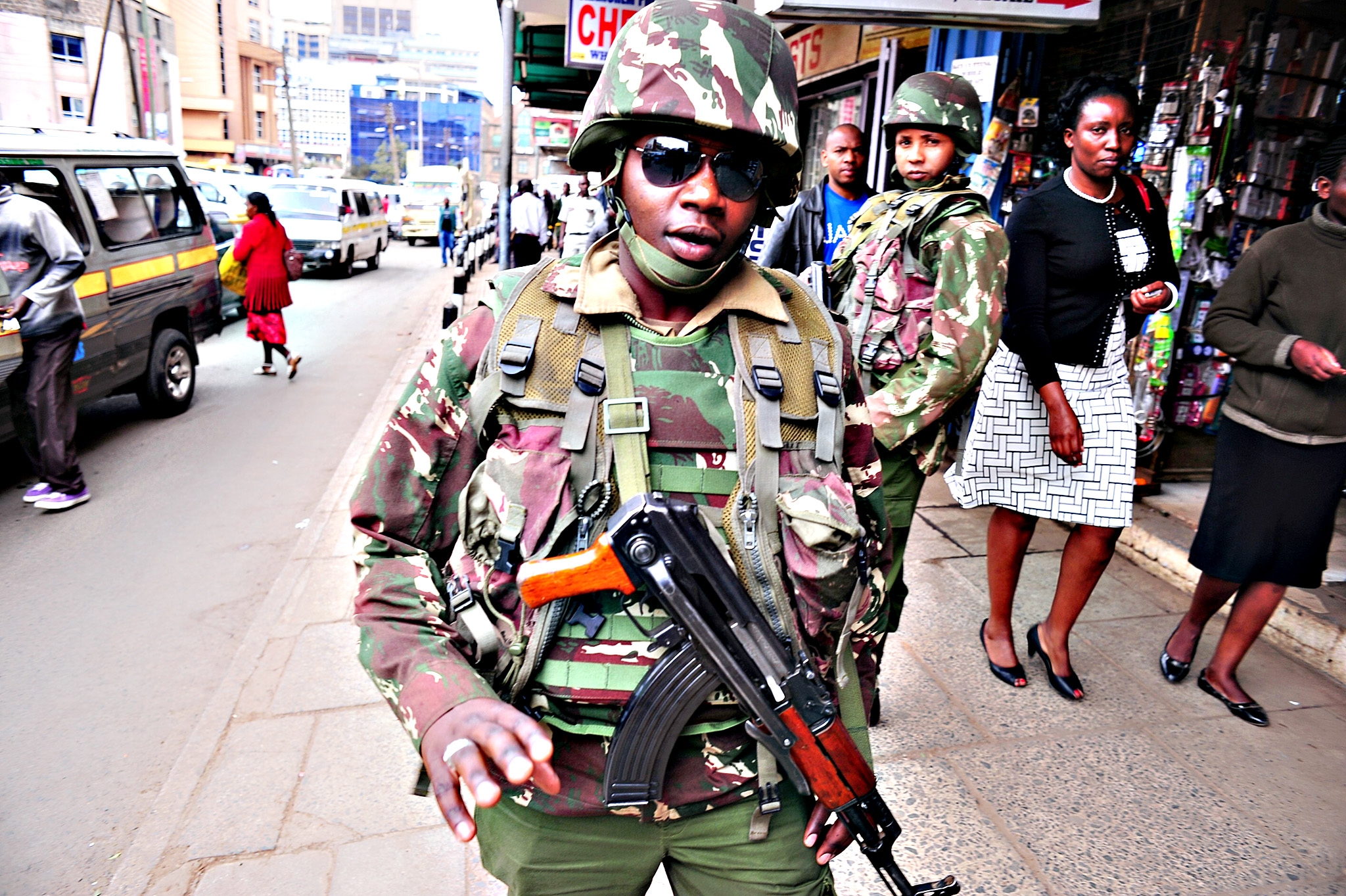 Police officers patrol along a street in Kenya's capital Nairobi on July 24, 2015, ahead of the visit of US President Barack Obama. Obama arrives in his ancestral homeland Kenya later today, with a massive security operation under way to protect him from Al-Qaeda-linked Somali militants