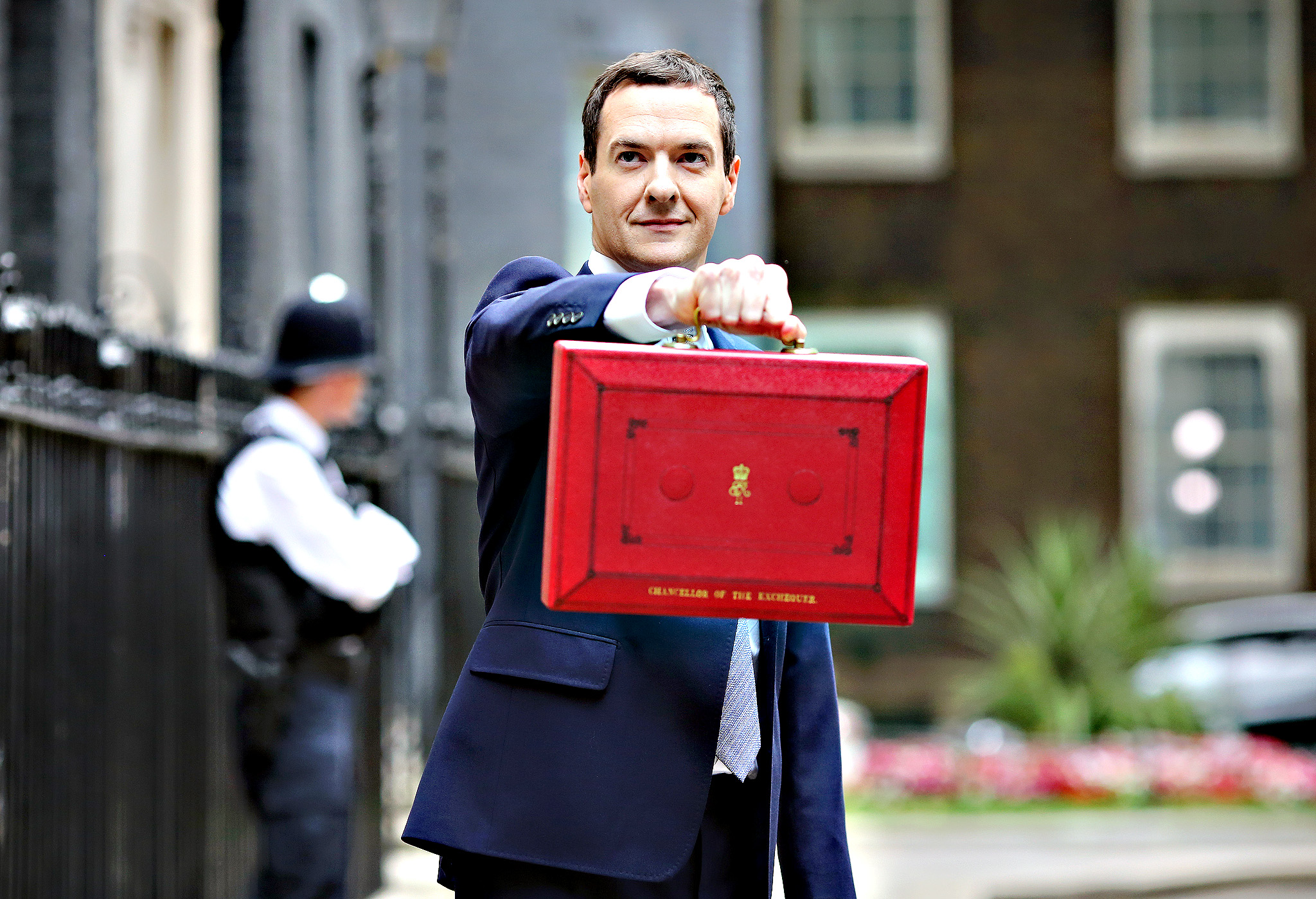 Chancellor, George Osborne, leaves Downing street to deliver the Budget on Wednesday. The first Budget after the Conservative party won the General Election in May B