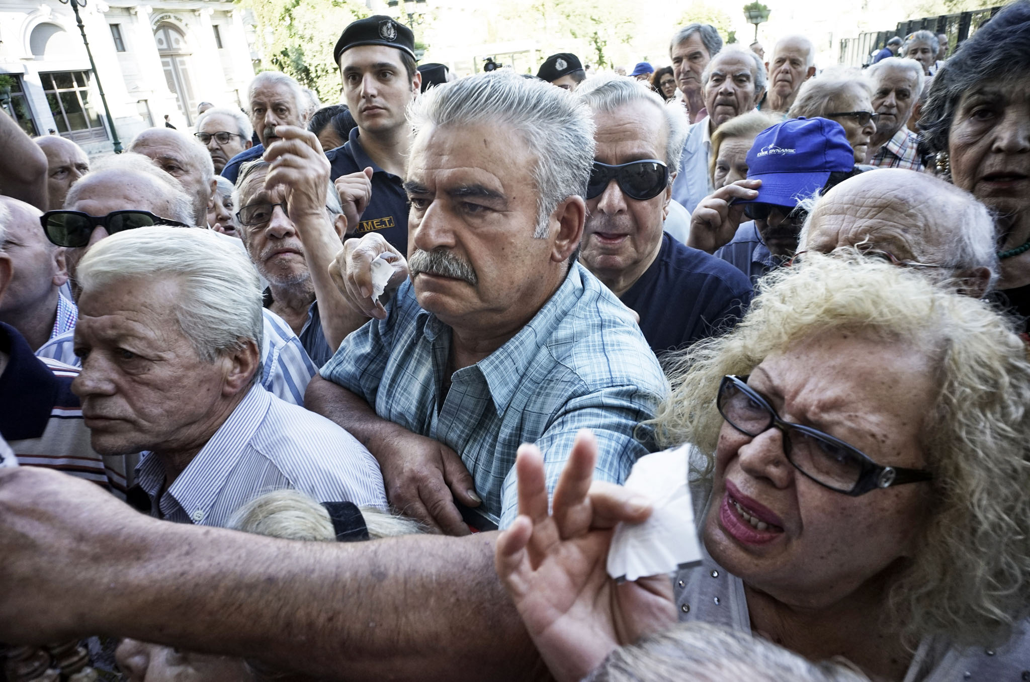 Pensioners line up outside a National Bank branch in Athens, Greece.