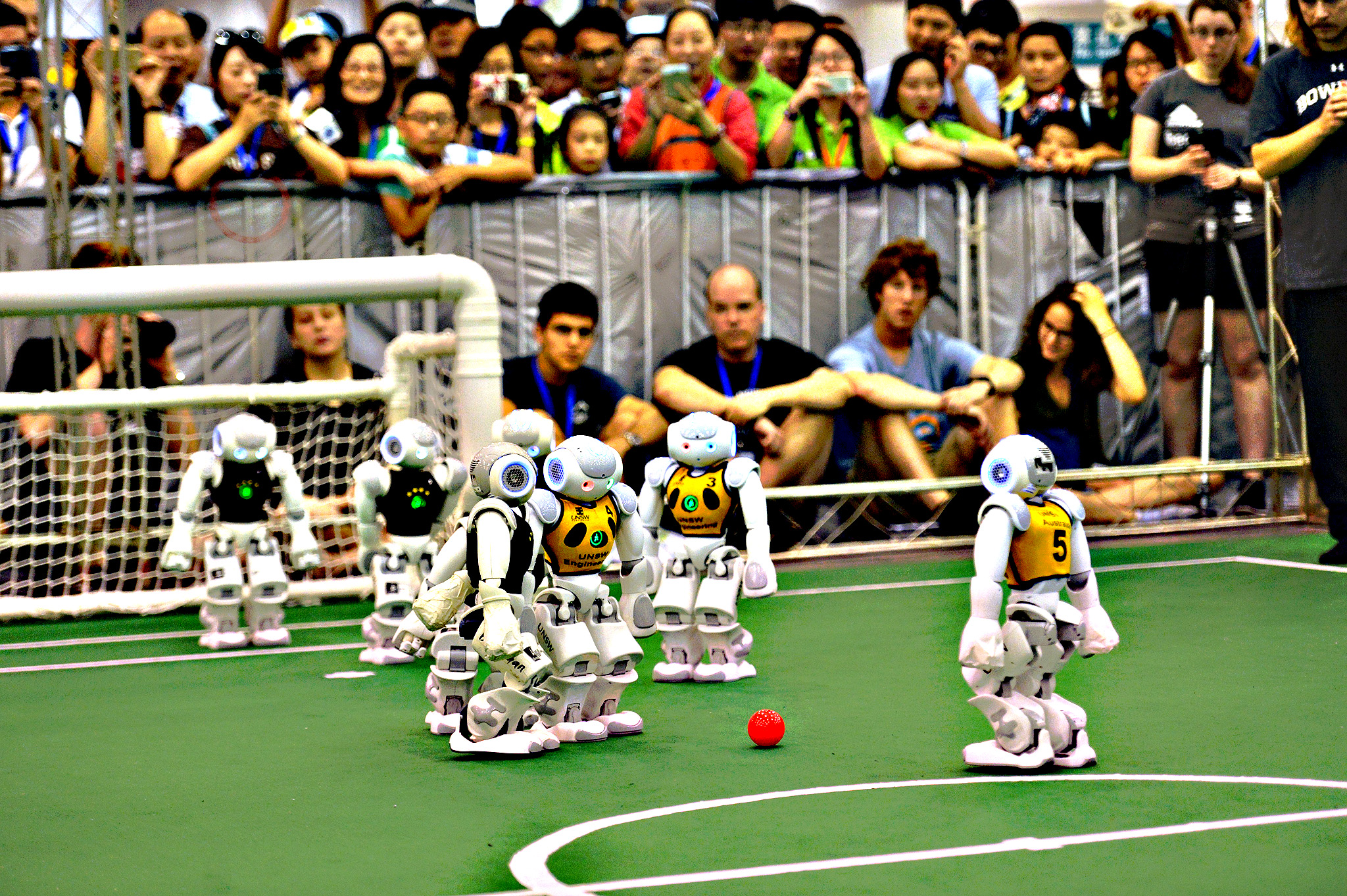Robots compete in a football match during the RoboCup 2015 in Hefei, east China's Anhui province on Wednesday