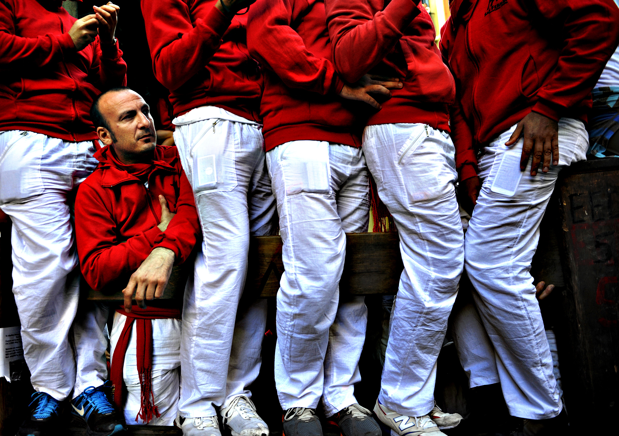 Revellers in traditional dress await the fourth running of the bulls on Estafeta corner at the San Fermin festival in Pamplona, northern Spain, July 10, 2015. One runner was hospitalized following the run that lasted two minutes and twenty-four seconds, according to local media