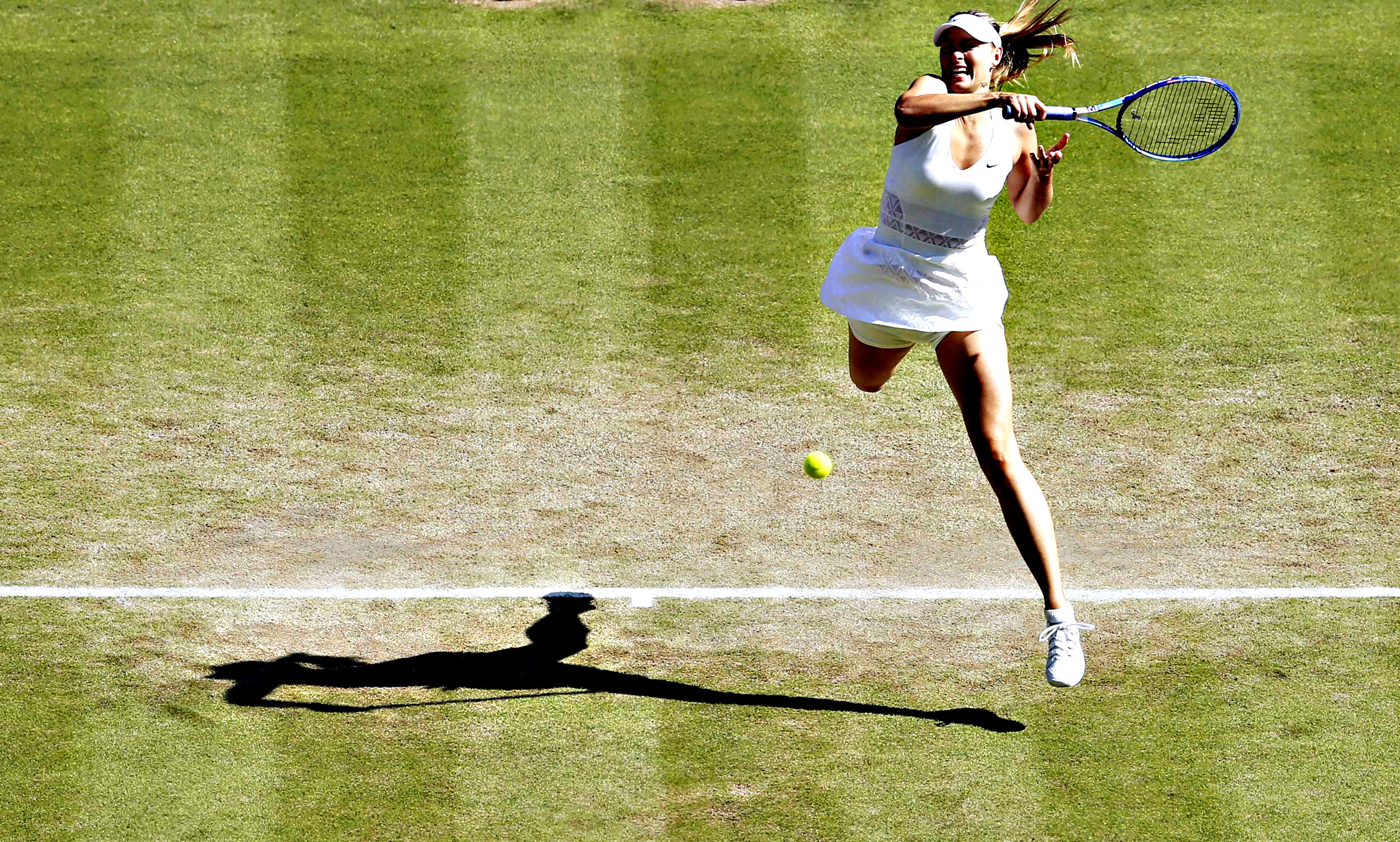 Maria Sharapova of Russia hits a shot during her match against Serena Williams of the U.S.A. at the Wimbledon Tennis Championships in London...Maria Sharapova of Russia hits a shot during her match against Serena Williams of the U.S.A. at the Wimbledon Tennis Championships in London, July 9, 2015.