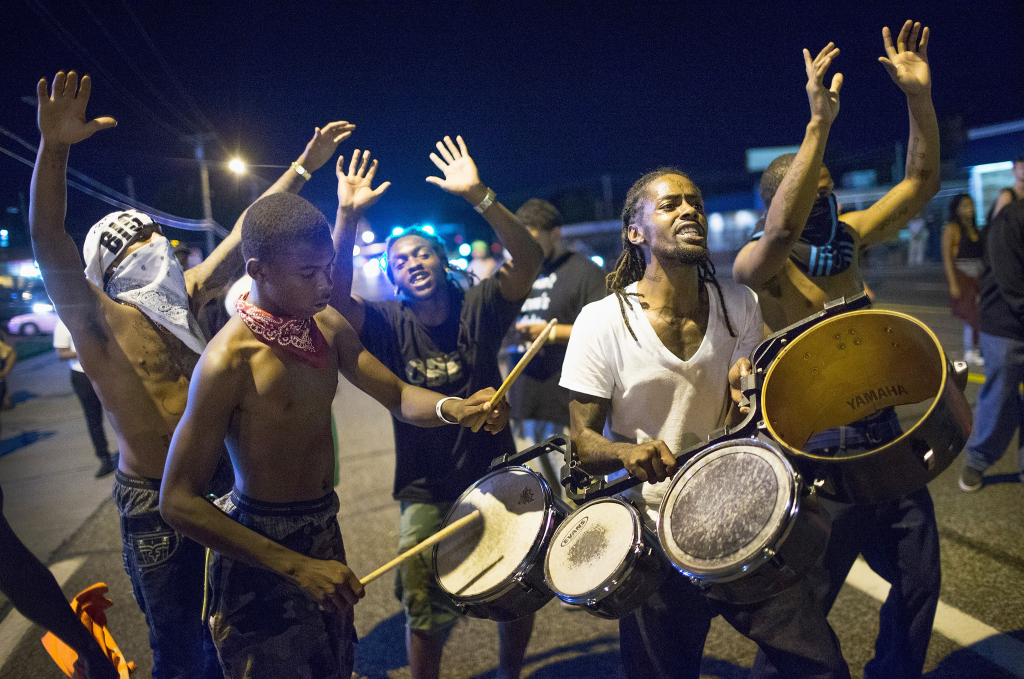 Ferguson Tense After Shootout On Anniversary Of Michael Brown's Death...FERGUSON, MO - AUGUST 10:  Demonstrators, marking the one-year anniversary of the shooting of Michael Brown, protest along West Florrisant Street on August 10, 2015 in Ferguson, Missouri. Mare than 100 people were arrested today during protests in Ferguson and the St. Louis area. Brown was shot and killed by a Ferguson police officer on August 9, 2014. His death sparked months of sometimes violent protests in Ferguson and drew nationwide focus on police treatment of black offenders.  (Photo by Scott Olson/Getty Images)