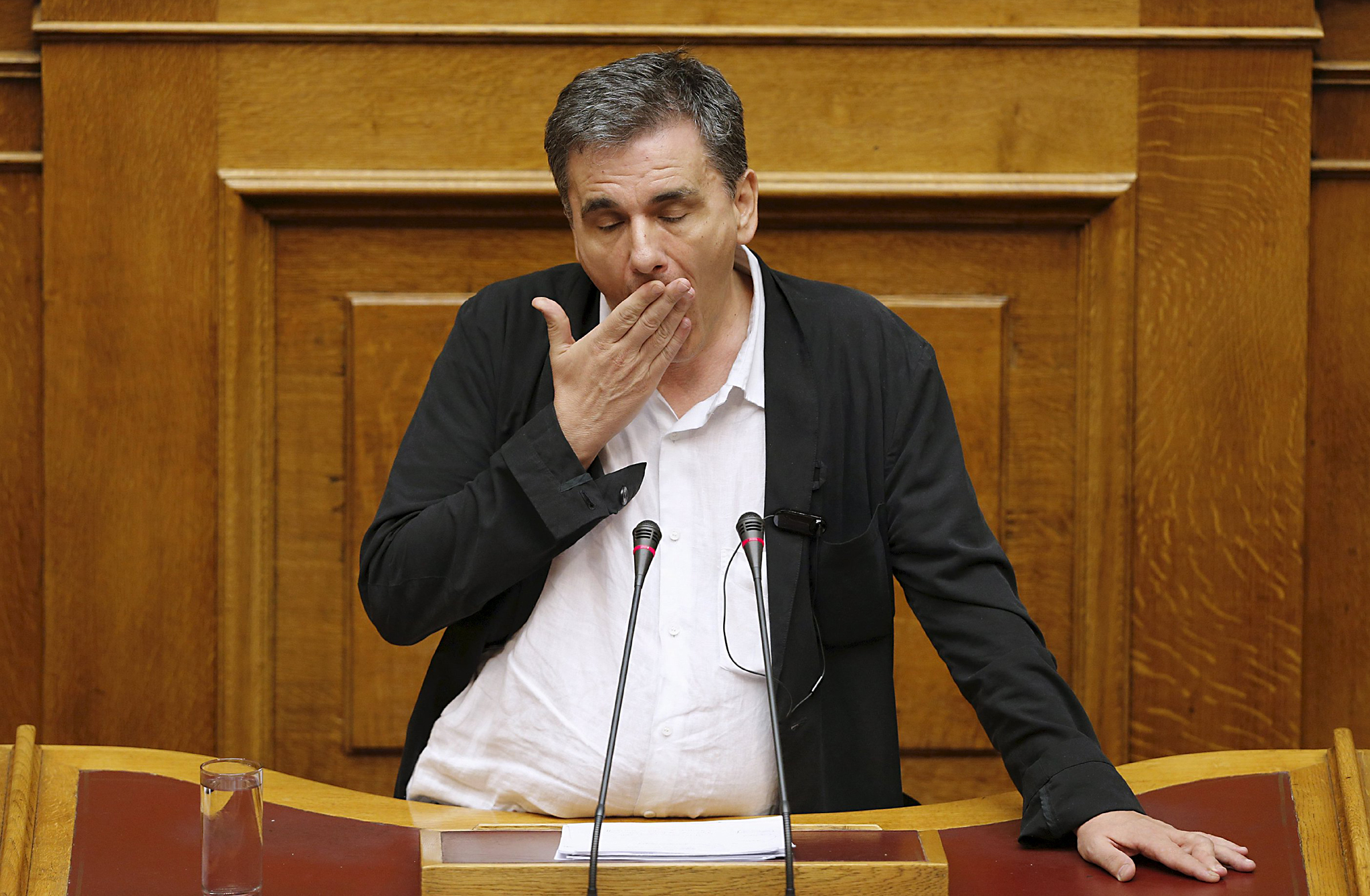 "Greek Finance Minister Euclid Tsakalotos reacts as deputies attempt to disrupt his speech during a night parliamentary session in Athens...ATTENTION EDITORS - REUTERS PICTURE HIGHLIGHTGreek Finance Minister Euclid Tsakalotos reacts as deputies attempt to disrupt his speech during a night parliamentary session in Athens, Greece, early August 14, 2015. Greek lawmakers debated a draft bill on the latest bailout deal, which the government hopes will be approved ahead of a euro zone finance ministers meeting in Brussels on Friday. REUTERS/Christian Hartmann  TPX IMAGES OF THE DAYREUTERS NEWS PICTURES HAS NOW MADE IT EASIER TO FIND THE BEST PHOTOS FROM THE MOST IMPORTANT STORIES AND TOP STANDALONES EACH DAY. Search for ""TPX"" in the IPTC Supplemental Category field or ""IMAGES OF THE DAY"" in the Caption field and you will find a selection of 80-100 of our daily Top Pictures.REUTERS NEWS PICTURES. TEMPLATE OUT"