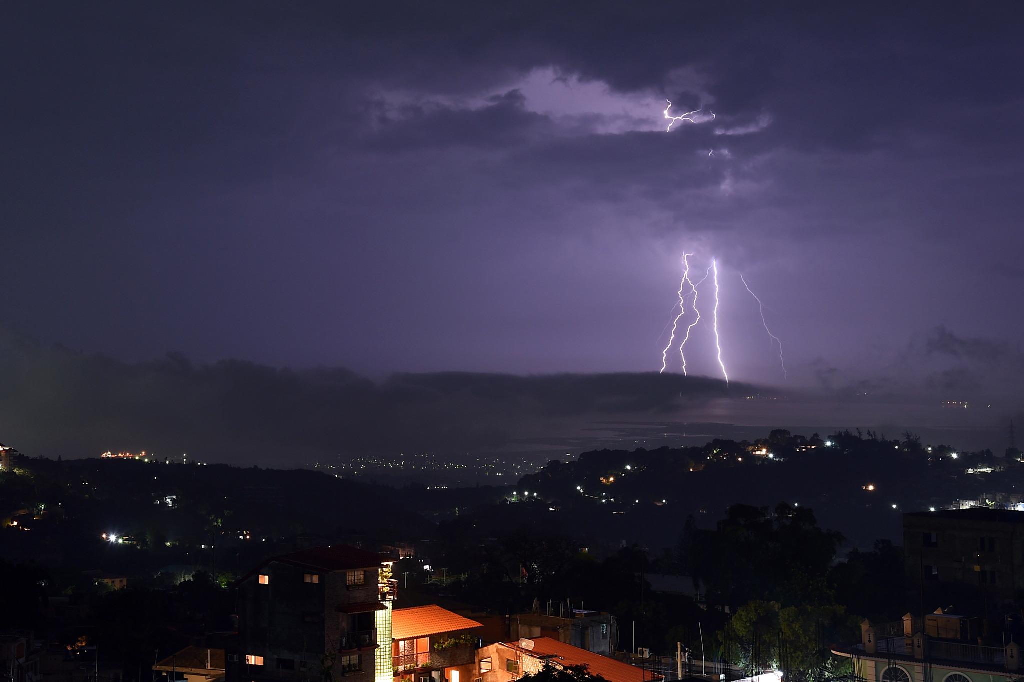 Lightning strikes during an evening thun...Lightning strikes during an evening thunderstorm on August 23, 2015 in the Haitian capital Port-au-Prince. AFP PHOTO/HECTOR RETAMALHECTOR RETAMAL/AFP/Getty Images
