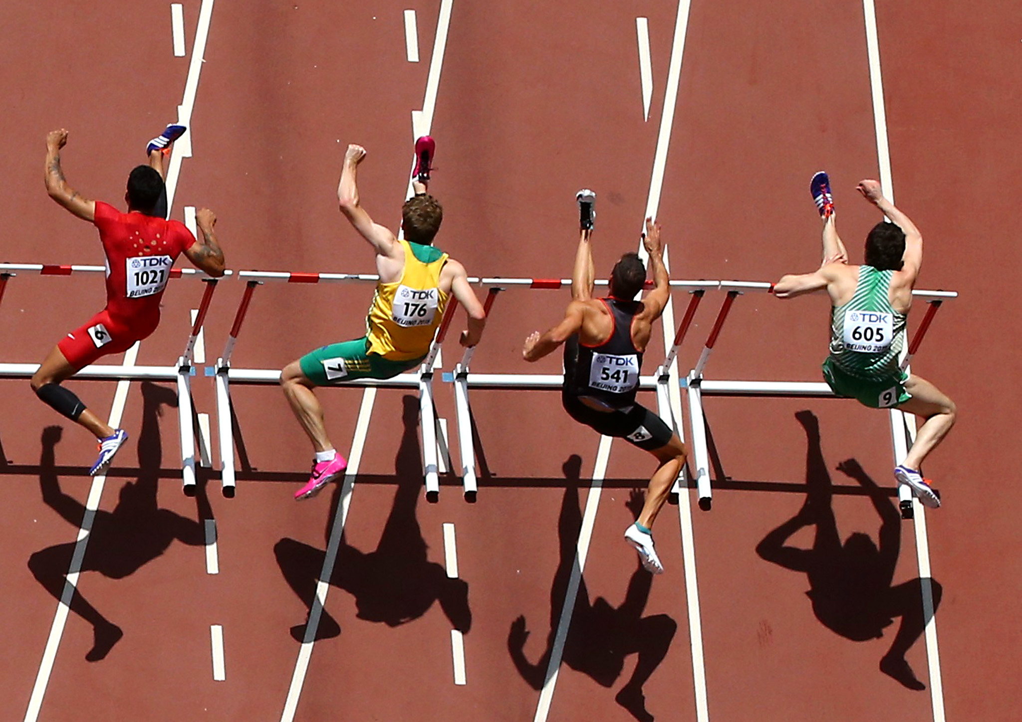 Athletes compete during their men's 110 metres hurdles heat at the IAAF World Championships at the National Stadium in Beijing...(L-R) Aleec Harris of the U.S., Nicholas Hough of Australia, Matthias Buhler of Germany and Ben Reynolds of Ireland compete during their men's 110 metres hurdles heat at the IAAF World Championships at the National Stadium in Beijing, China August 26, 2015. REUTERS/Pawel Kopczynski