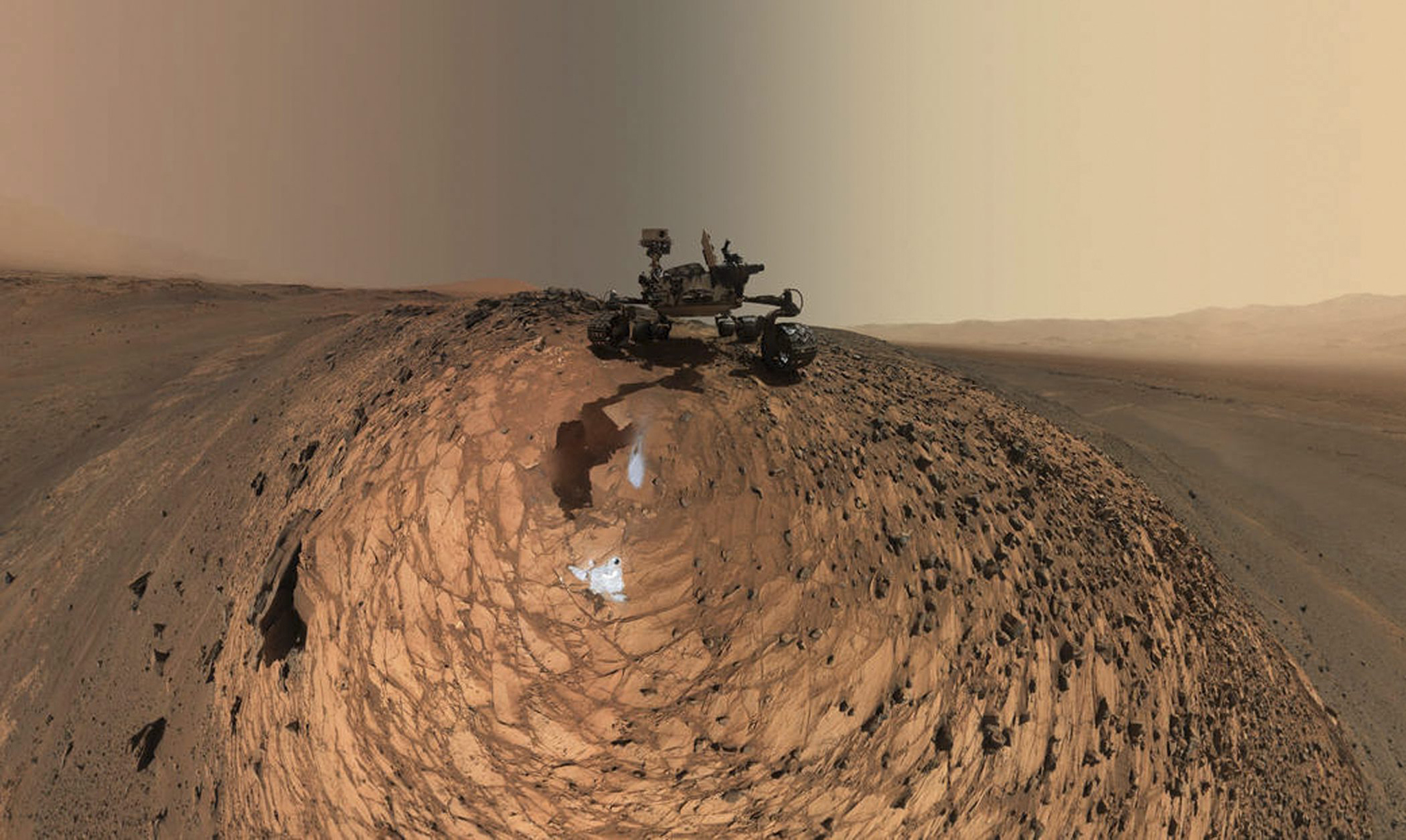 low-angle self-portrait of NASA's Curiosity Mars rover...epa04890875 A handout picture released by NASA on 20 August 2015 shows a low-angle self-portrait of NASA's Curiosity Mars rover  vehicle above the 'Buckskin' rock target, in the 'Marias Pass' area of lower Mount Sharp on Mars, where the mission collected its seventh drilled sample, taken on 05 August 2015. The scene combines dozens of images taken by Curiosity's Mars Hand Lens Imager (MAHLI) during the 1,065th Martian day, or sol, of the rover's work on Mars. For scale, the rover's wheels are 20 inches (50 centimeters) in diameter and about 16 inches (40 centimeters) wide.  EPA/NASA/JPL-Caltech/MSSS  HANDOUT EDITORIAL USE ONLY