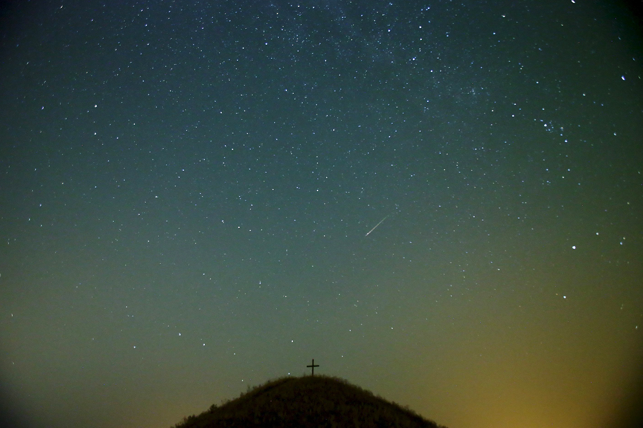 "A meteor streaks across the sky over Leeberg hill during the Perseid meteor shower near Grossmugl...ATTENTION EDITORS - REUTERS PICTURE HIGHLIGHTA meteor streaks across the sky over Leeberg hill during the Perseid meteor shower near Grossmugl in the early morning of August 13, 2015. The annual Perseid meteor shower reaches its peak on August 12 and 13 in Europe, according to NASA. REUTERS/Heinz-Peter Bader       TPX IMAGES OF THE DAYREUTERS NEWS PICTURES HAS NOW MADE IT EASIER TO FIND THE BEST PHOTOS FROM THE MOST IMPORTANT STORIES AND TOP STANDALONES EACH DAY. Search for ""TPX"" in the IPTC Supplemental Category field or ""IMAGES OF THE DAY"" in the Caption field and you will find a selection of 80-100 of our daily Top Pictures.REUTERS NEWS PICTURES. TEMPLATE OUT"
