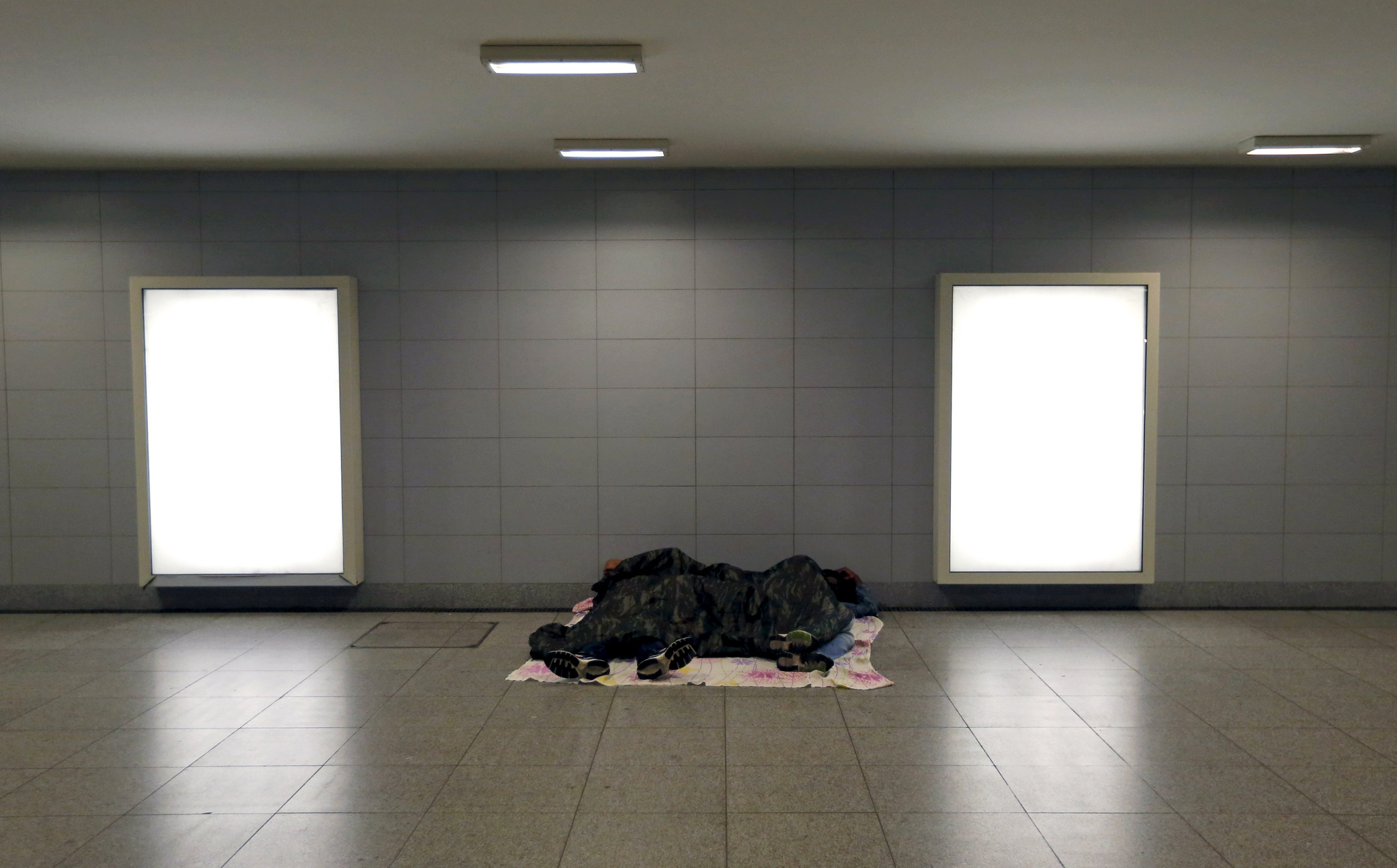 Migrants sleep outside a train station in Budapest...Migrants sleep outside a train station in Budapest, Hungary, August 3, 2015. While Hungary is an avenue rather than a destination for the migrants, the central European country is increasingly weary and polarised as the influx grows. Conflicts have begun to appear, and the government is taking an ever harder line. Picture taken August 3, 2015. REUTERS/Laszlo Balogh