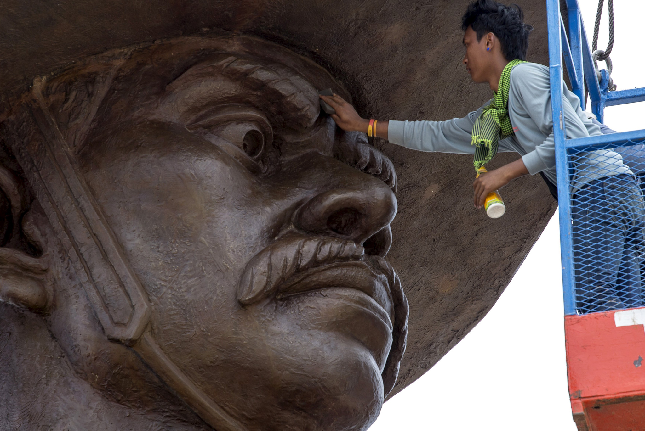 A labourer works on a giant bronze statue of former King Taksin at Ratchapakdi Park in Hua Hin, Prachuap Khiri Khan province, Thailand. The park is being constructed by the Thai army to honor past Thai monarchs and is situated on an army compound near the Klai Kangwon Palace.