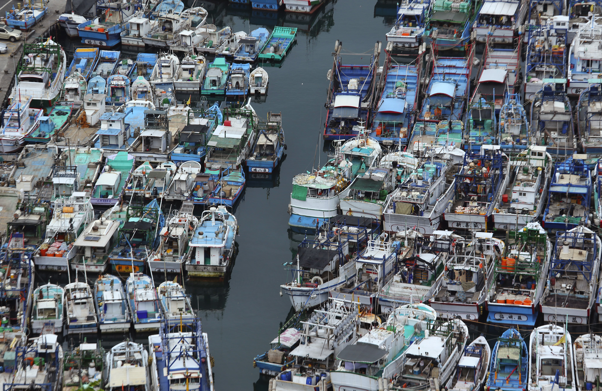 Fishing boats are secured in a port in Yilan County, Taiwan, as Typhoon Soudelor approaches.