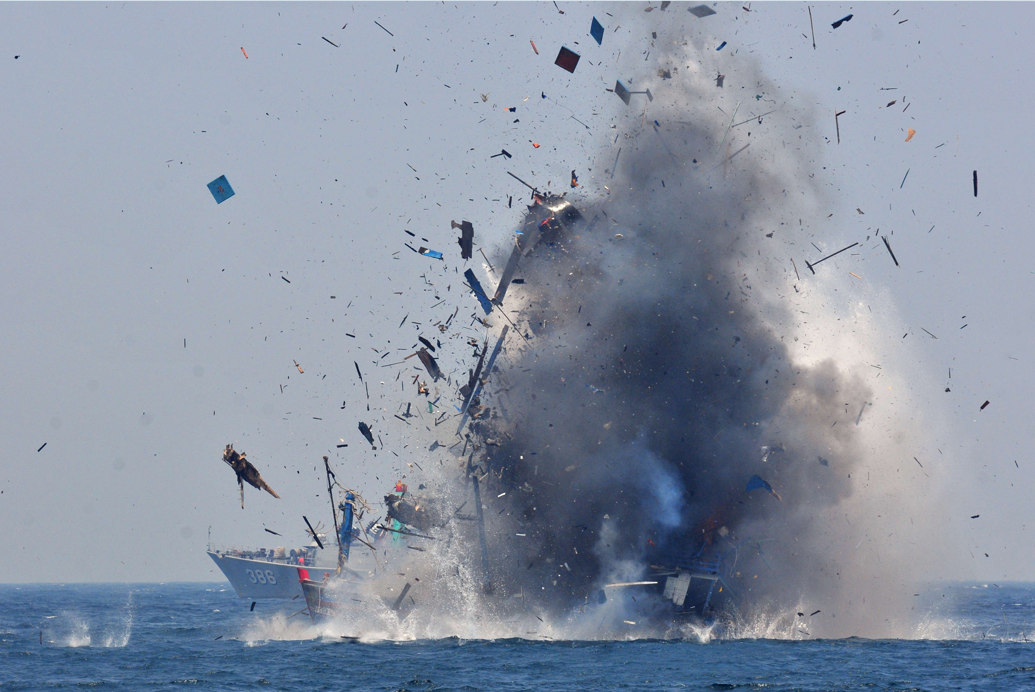 Foreign fishing boats seized by Indonesian authorities, for illegal fishing, are blown up by Navy personnel off Pontianak in West Kalimantan province, located in Borneo island.