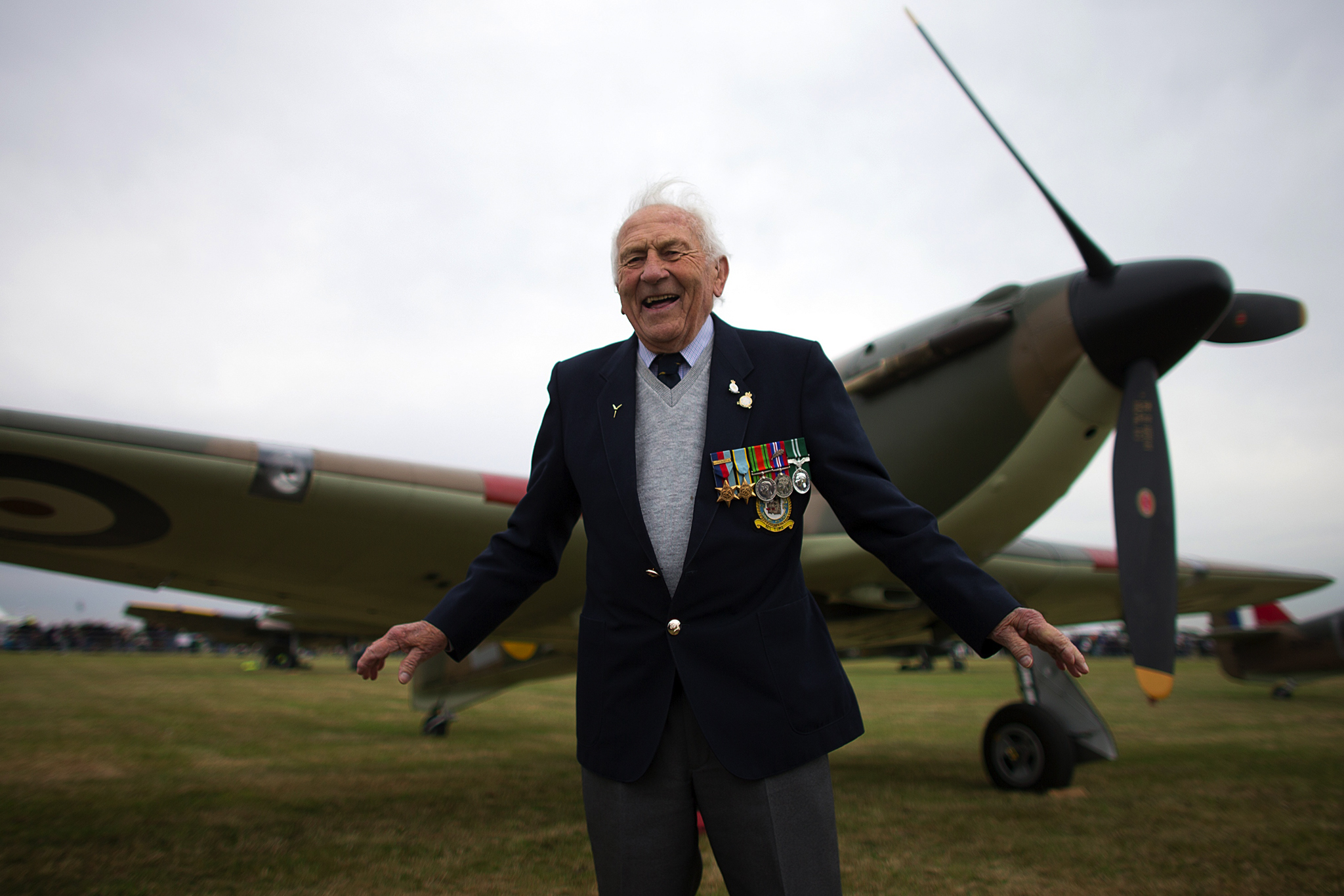 "Tony Pickering, who served as a Hurricane pilot in the World War Two, poses for a photograph next to a Hurricane at Biggin Hill, England.  Aircraft including 18 Spitfires and six Hurricanes flew over southern England to mark 75 years since the Battle of Britain's ""Hardest Day"" when Biggin Hill and other South East military bases came under attack from the German Luftwaffe"