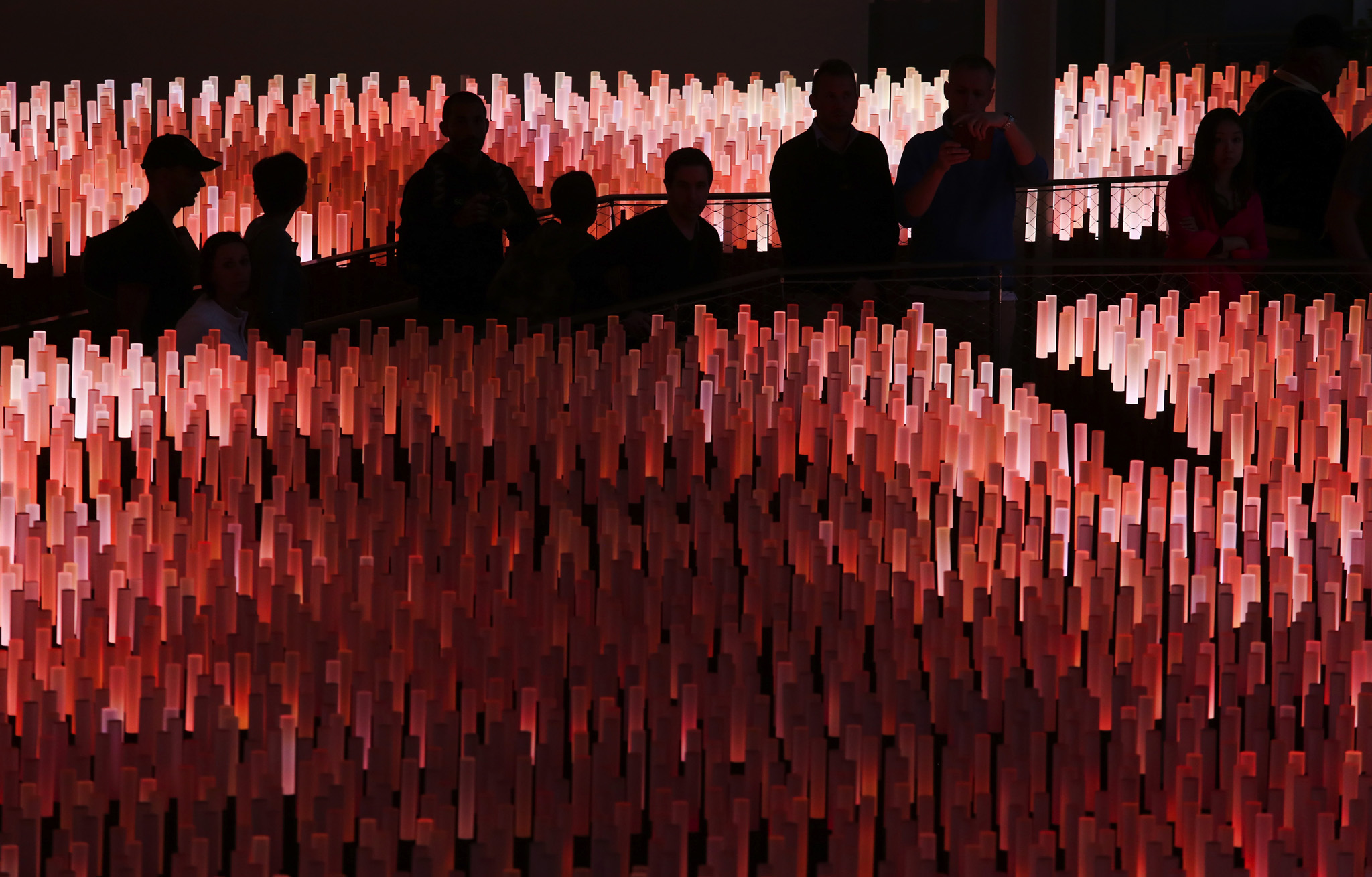 Visitors view a giant light installation inside the China pavilion at the Expo 2015 exhibition in Milan, Italy.
