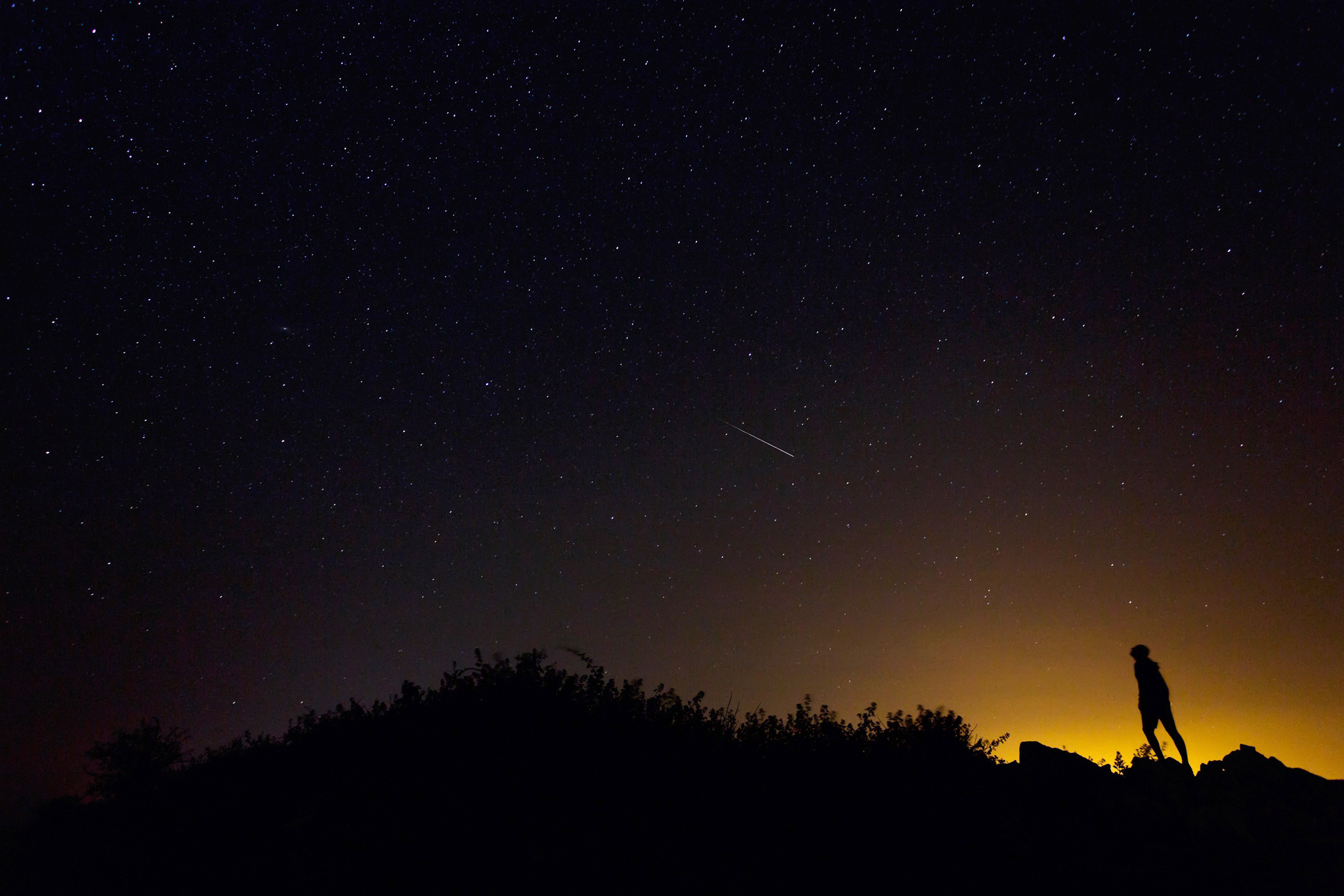 "TOPSHOTS TOPSHOTS A Perseid meteor along...TOPSHOTS TOPSHOTS A Perseid meteor along the Milky Way illuminates the dark sky near Villadiego in the province of Burgos, northern Spain, during the  ""Perseids"" meteor shower on August 12, 2015. AFP PHOTO/ CESAR MANSOCESAR MANSO/AFP/Getty Images"