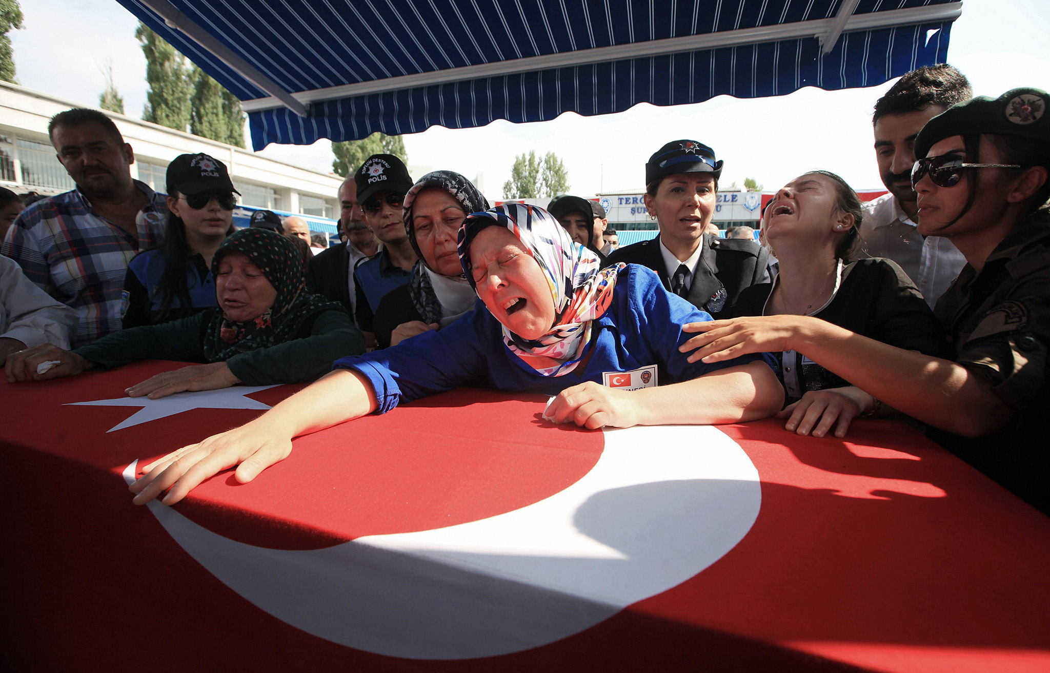 Hulya Aydin (C), mother of Turkish polic...Hulya Aydin (C), mother of Turkish police officer Sahin Polat Aydin killed in an attack, mourns over her son's coffin during his funeral in Ankara on August 11, 2015. Turkish warplanes carried out a new wave of air strikes against Kurdish militants in the southeast of the country in retaliation for a day of bloody attacks that left six members of the security forces dead. AFP PHOTO / ADEM ALTANADEM ALTAN/AFP/Getty Images
