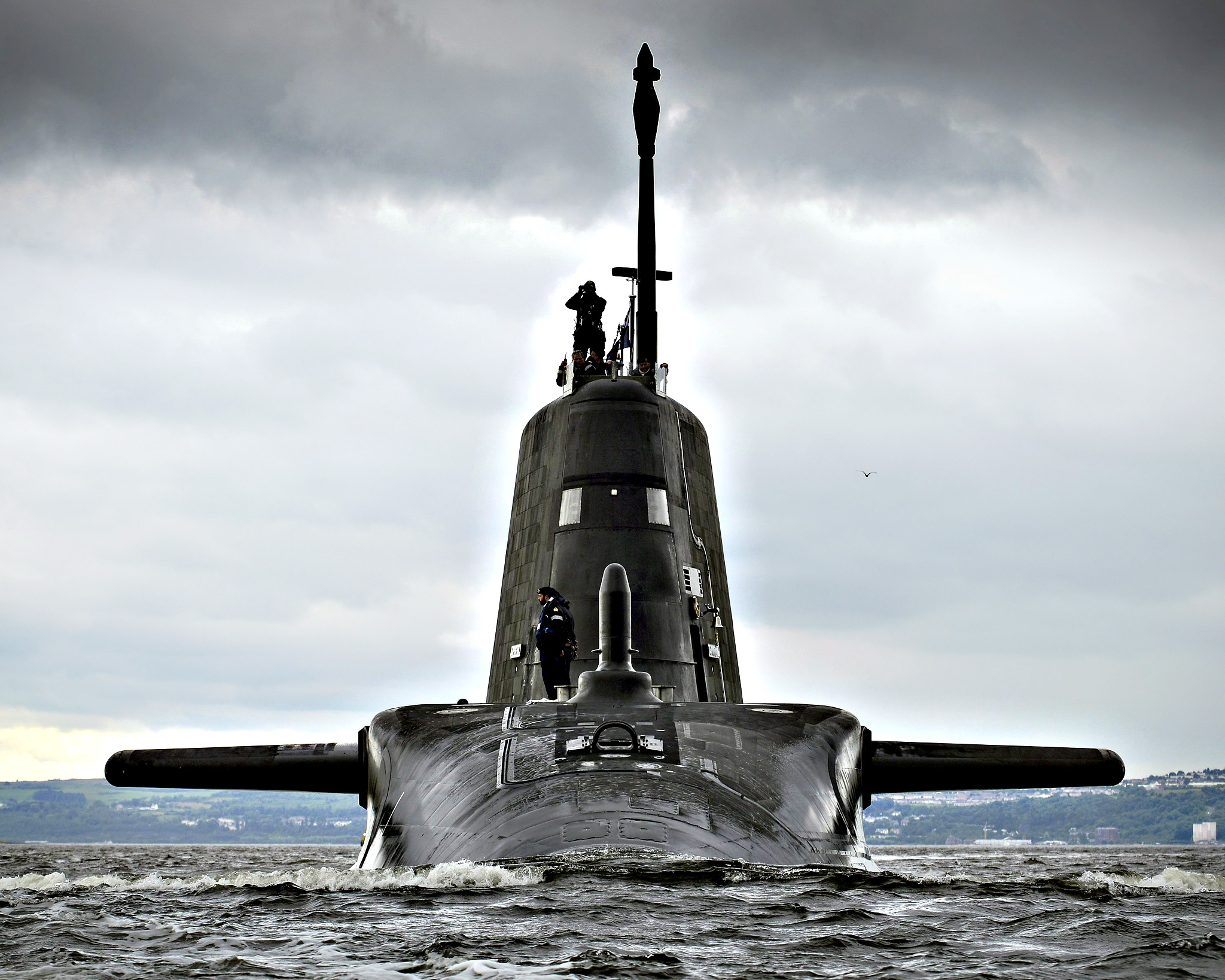 HMS Artful, the third of the British Royal Navy's new Astute Class attack submarines on arrival at her Scottish base port of HMNB Clyde, Faslane, Scotland, 19 August 2015 from where she will carry out sea trials before entering service later this year. The 7,400-tonne Artful left BAE Systems construction yard at Barrow-in-Furness in Cumbria several days ago before sailing to her new home at Her Majesty s Naval Base (HMNB) Clyde. She will provide the Royal Navy with the most technologically advanced submarine Britain has ever sent to sea. HMNB Clyde will become a home for the Royal Navy s submarines and associated support by 2020, creating a submarine centre of specialisation. The base is amongst the largest single-site employers in Scotland, with 6,700 military and civilian personnel, increasing under current UK Government plans to 8,200 by 2022.