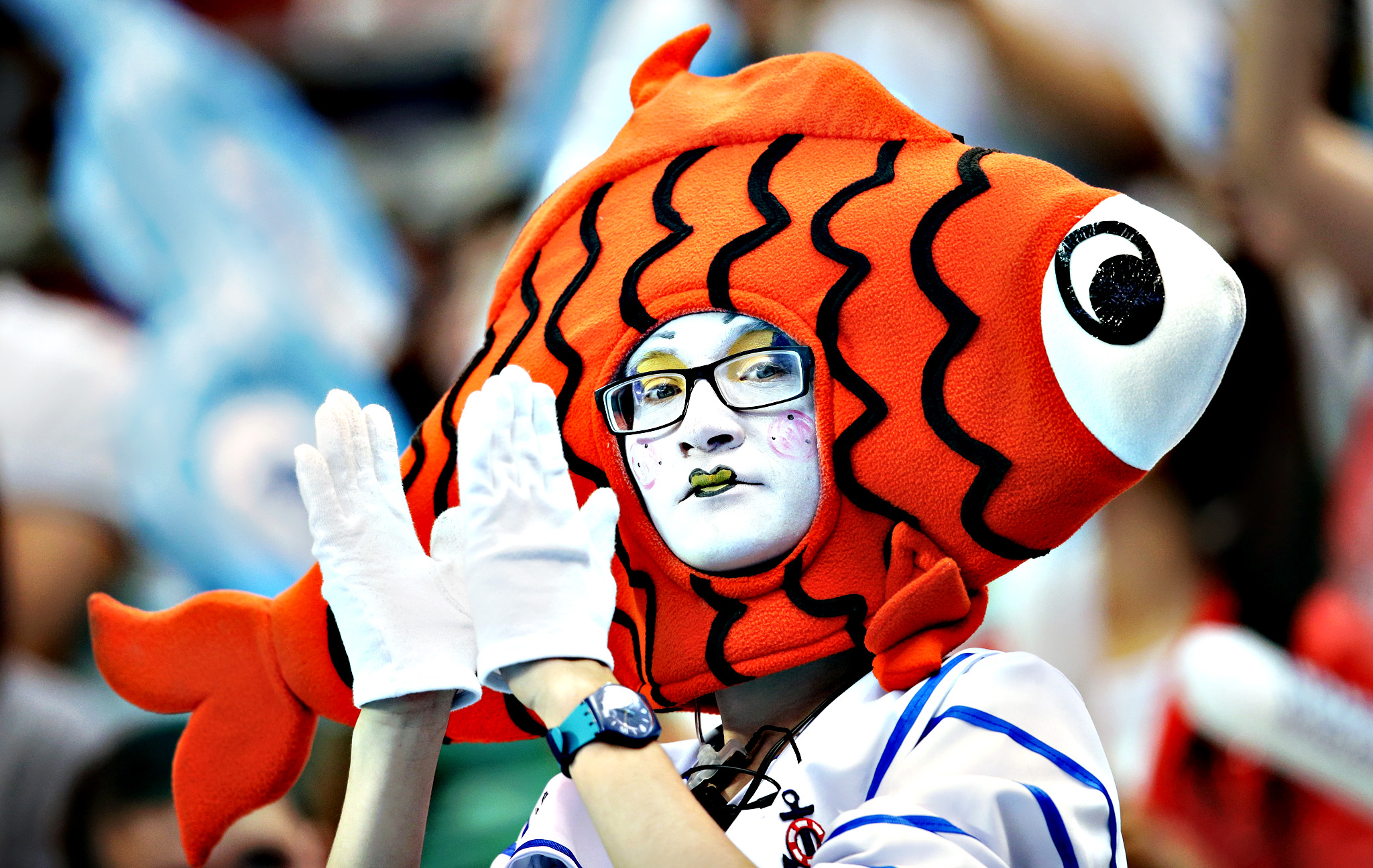 A spectator watches the morning heats at the Swimming World Championships in Kazan, Russia, Monday, Aug. 3, 2015