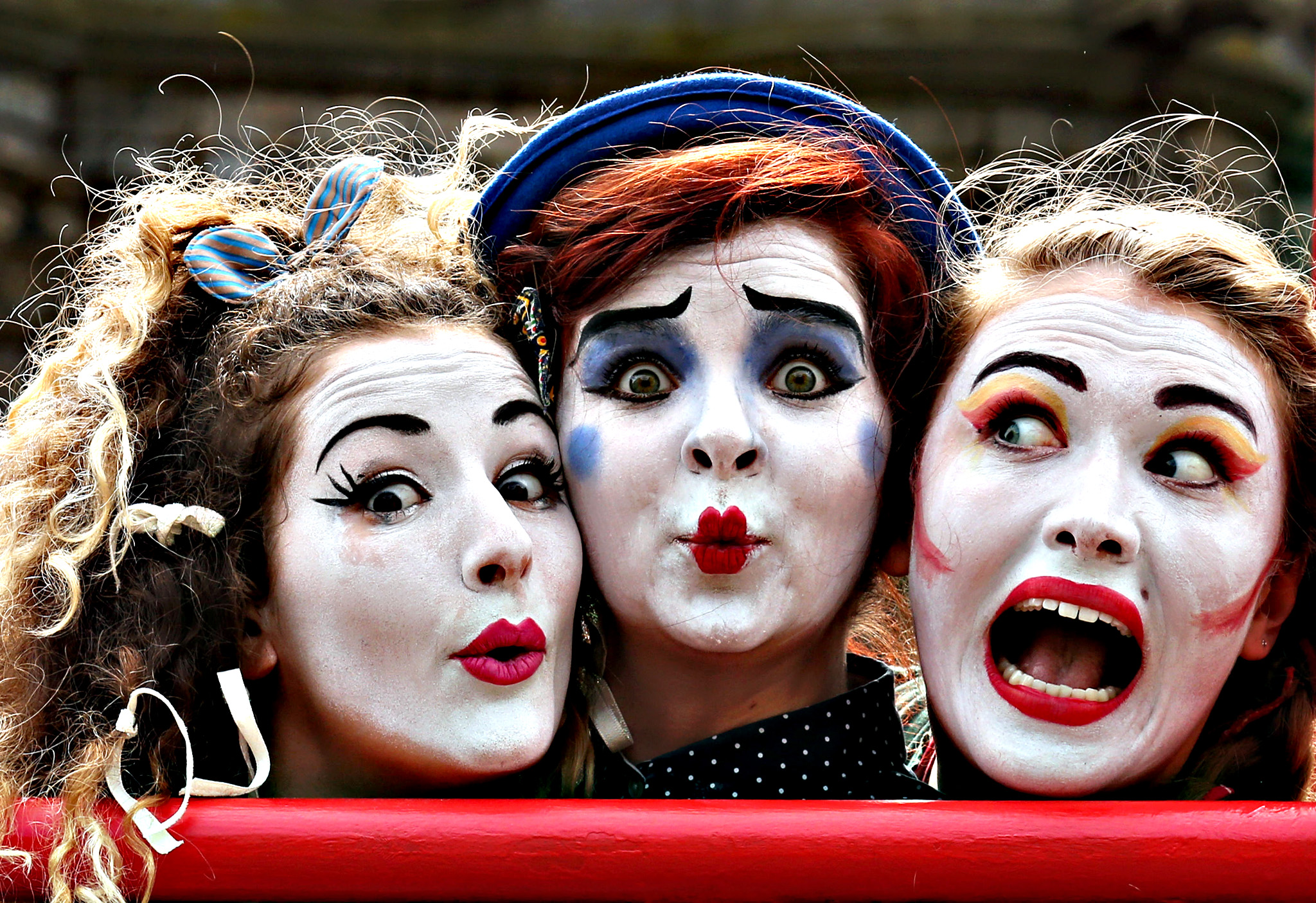 "Performers Fleur Tooth, Florence O'Mahony and Rosalind Hoy from the Human Zoo Theatre Company, on the Royal Mile in Edinburgh, advertise their act ""The Girl Who Fell In love With The Moon"" which is on at the  Pleasance Dome, ahead of the Edinburgh Fringe Festival"