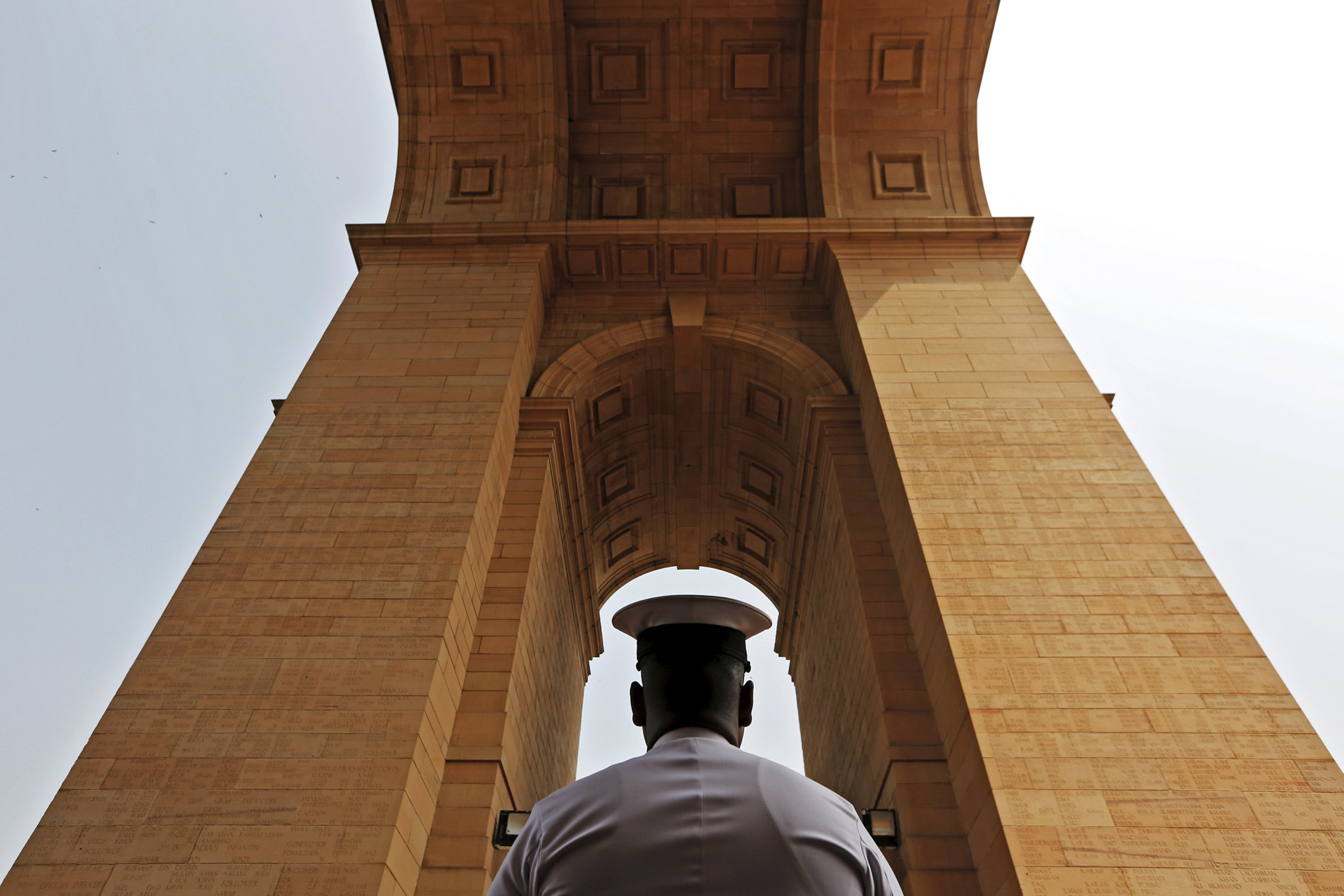 n Indian Naval soldier pays respect at the India Gate war memorial during a ceremony to commemorate 50th anniversary of a war between India and Pakistan, in New Delhi, India