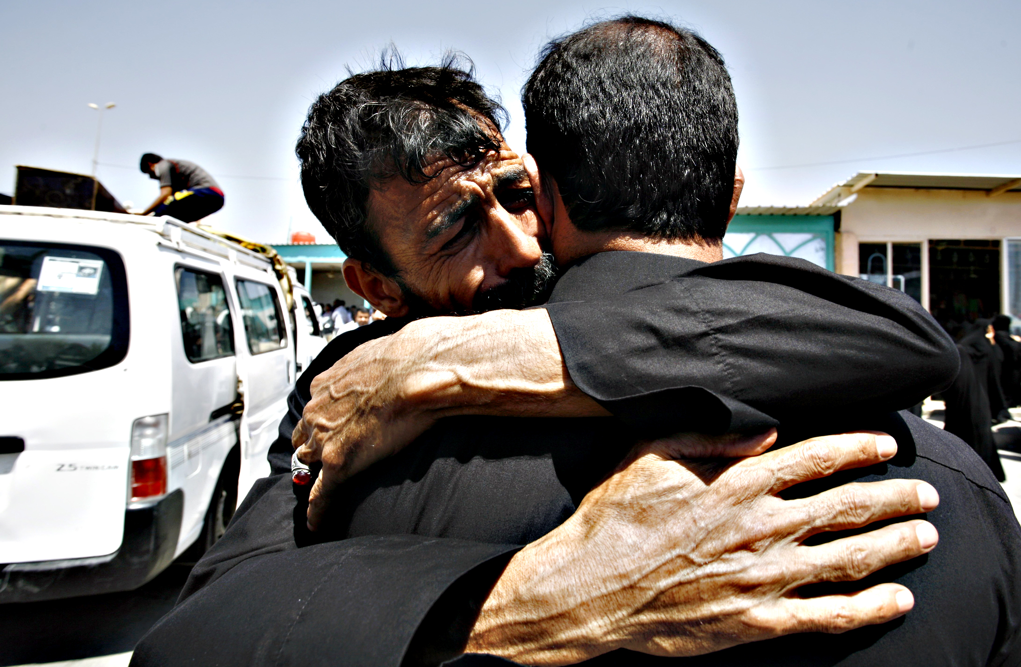 Iraqi men mourn outside a mosque in the holy city of Najaf on Thursday during the funeral of Shia victims of this morning's truck bombing in Baghdad's northern suburb of Sadr City