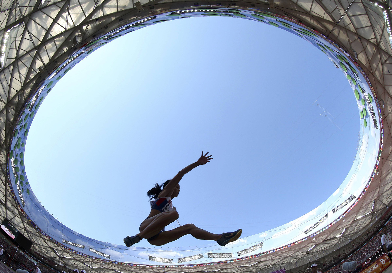 Johnson-Thompson of Britain competes in the women's long jump qualifying round during the 15th IAAF World Championships at the National Stadium in Beijing