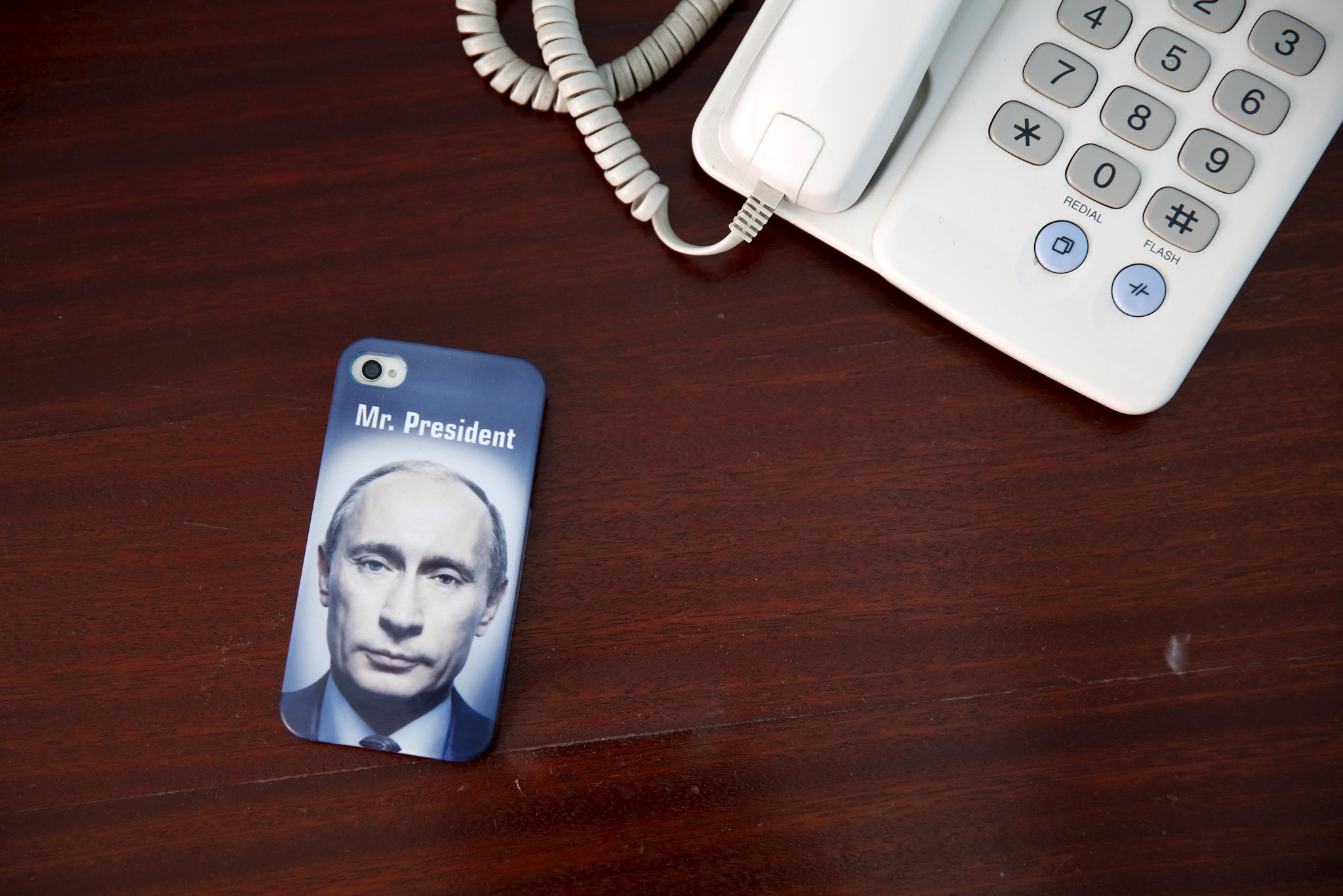 "A mobile phone cover with a picture of Russian President Vladimir Putin and which reads ""Mr President"""