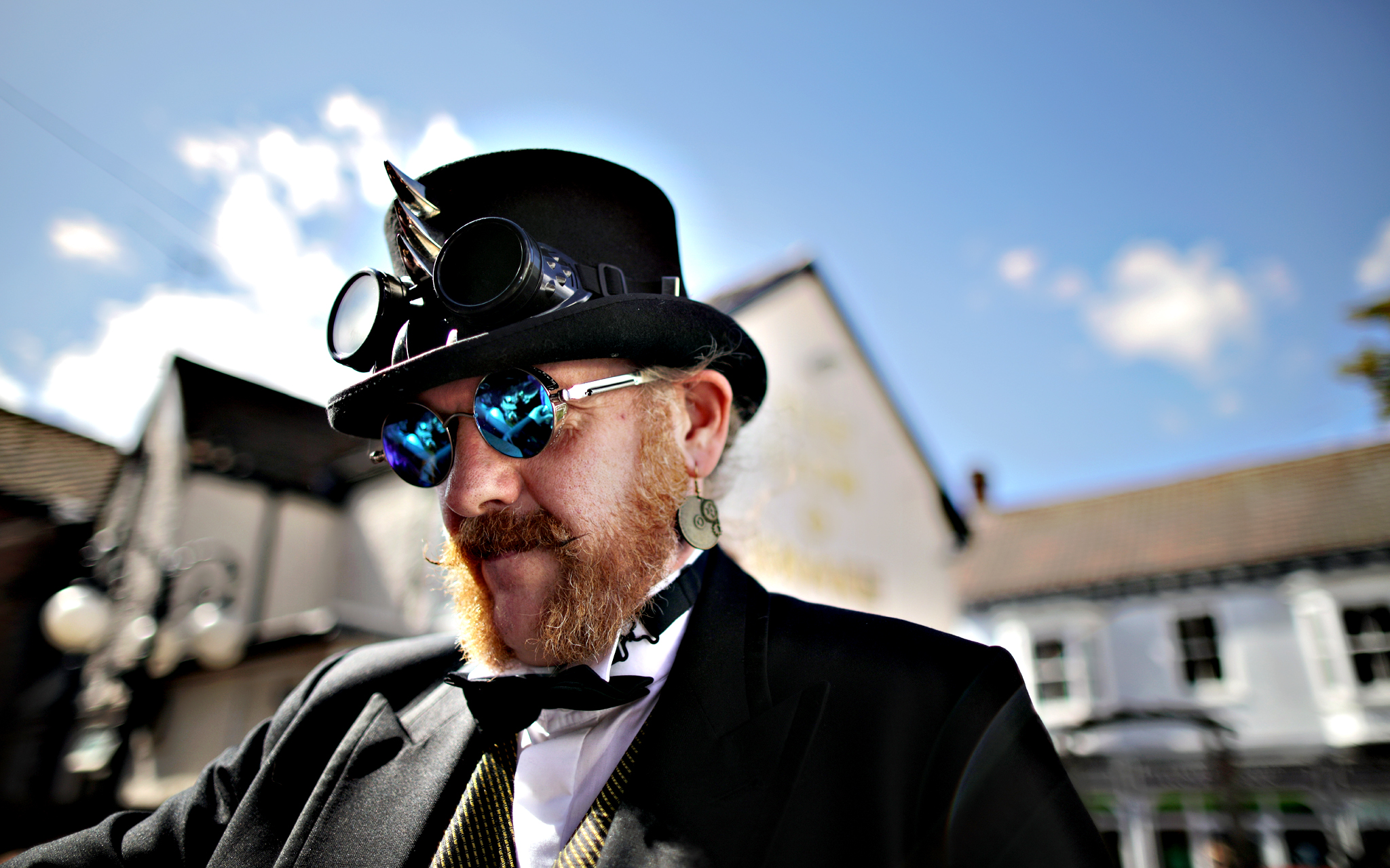 Steampunk enthusiasts arrive to attend the Asylum Steampunk festival on August 28, 2015 in Lincoln, England. The Asylum Steampunk Festival is the largest and longest running steampunk festival in the world and attracts participants from around the globe. During the weekend festival the picturesque and historic City of Lincoln is transformed by followers who attend. Steampunk refers to a subgenre of science fiction and literature that incorporates technology and clothing inspired by 19th-century industrial steam-powered machinery