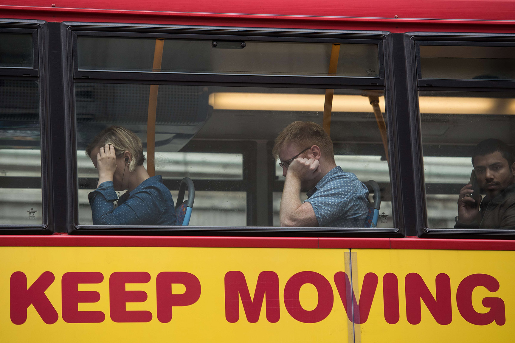 Commuters sit in traffic on a bus
