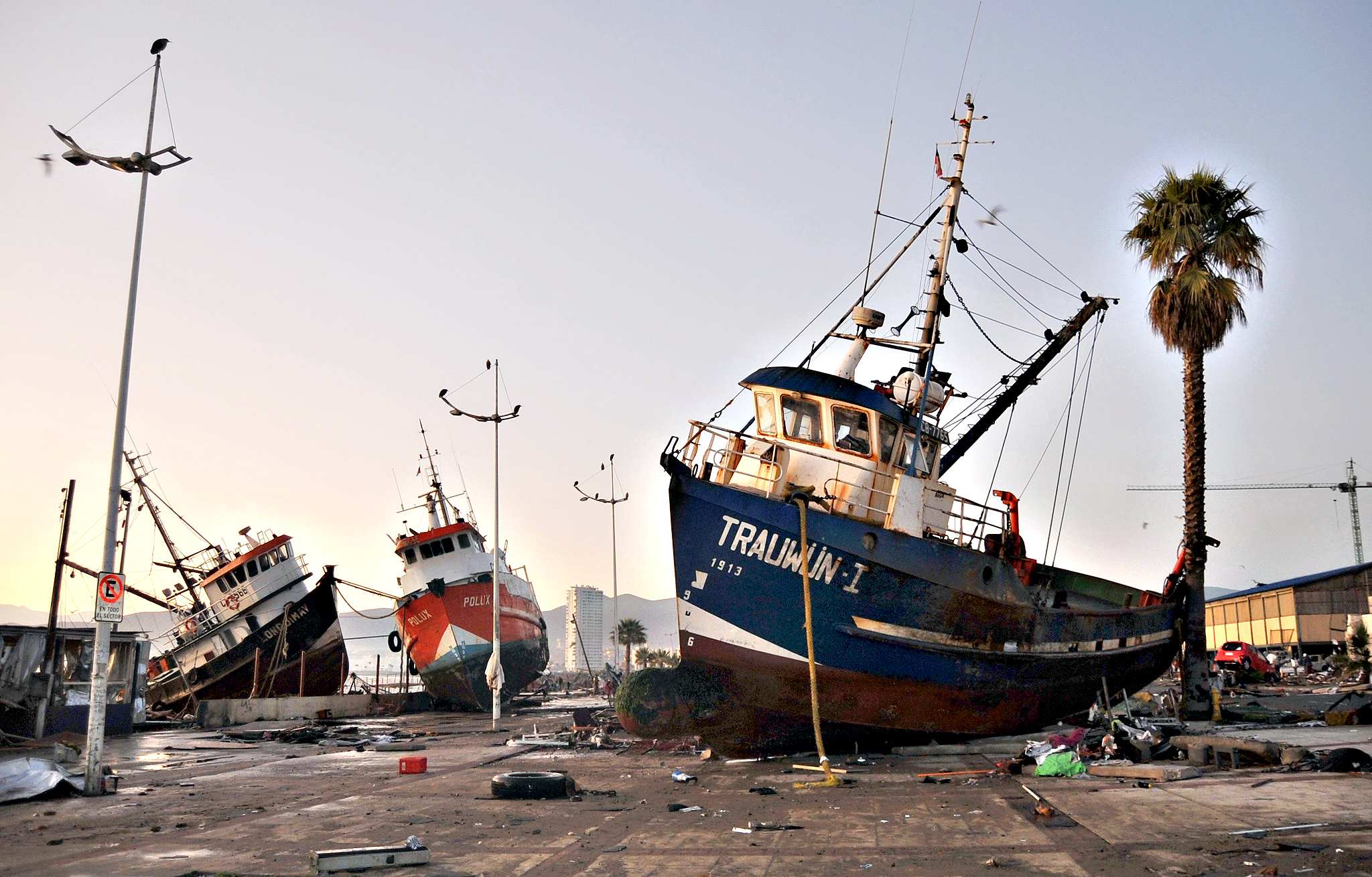 Ships are seen in the street after an earthquake hit areas of central Chile, in Coquimbo city, north of Santiago, Chile, September 17, 2015. Strong aftershocks rippled through Chile on Thursday after a magnitude 8.3 earthquake that killed at least eight people and slammed powerful waves into coastal towns, forcing more than a million people from their homes