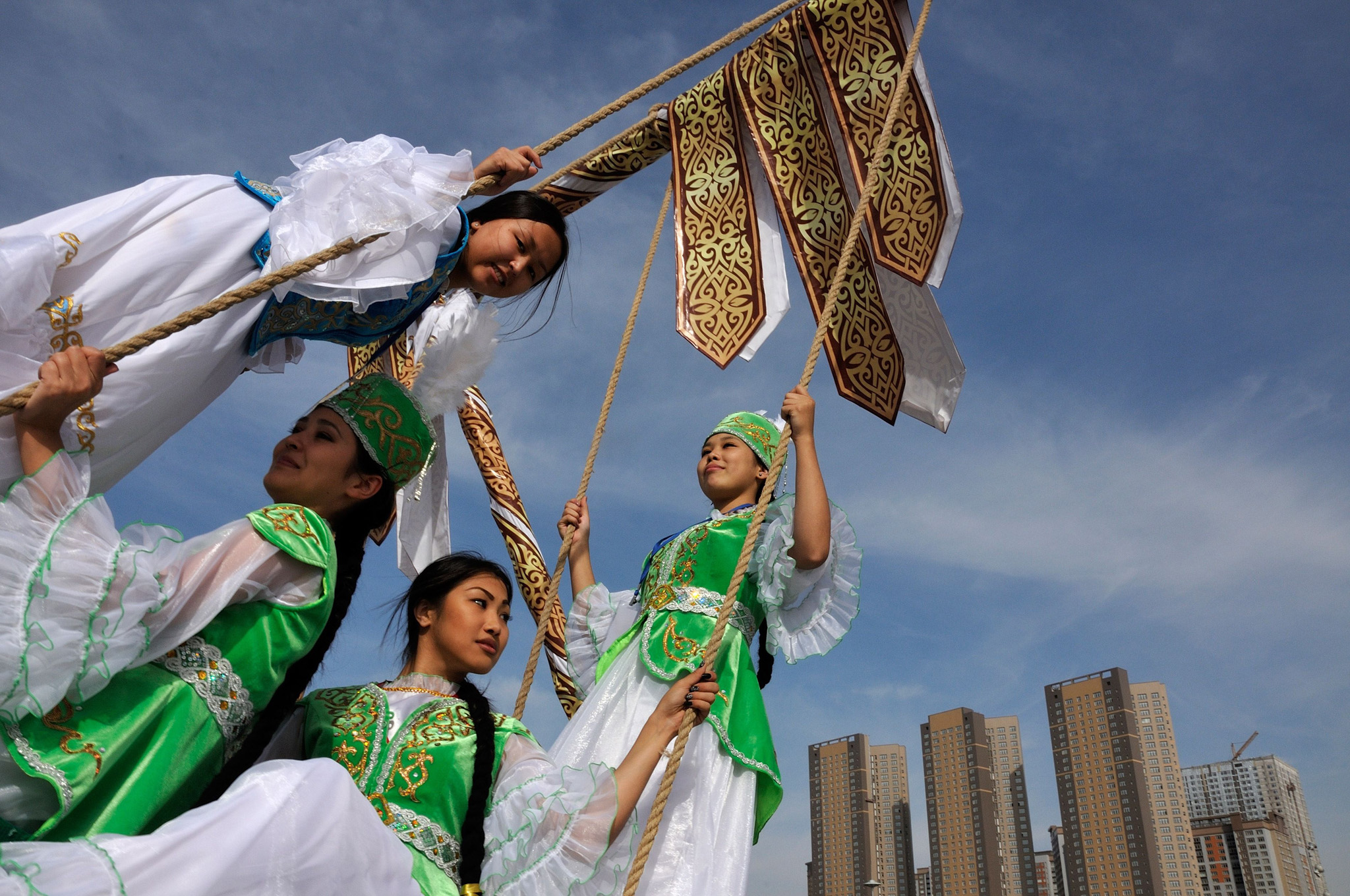 Kazakh women wearing traditional costume...Kazakh women wearing traditional costumes play on a swing during celebrations marking the 550th anniversary of Kazakh statehood in central Astana on September 11, 2015. AFP PHOTO / BOLAT SHAIKHINOVBOLAT SHAIKHINOV/AFP/Getty Images