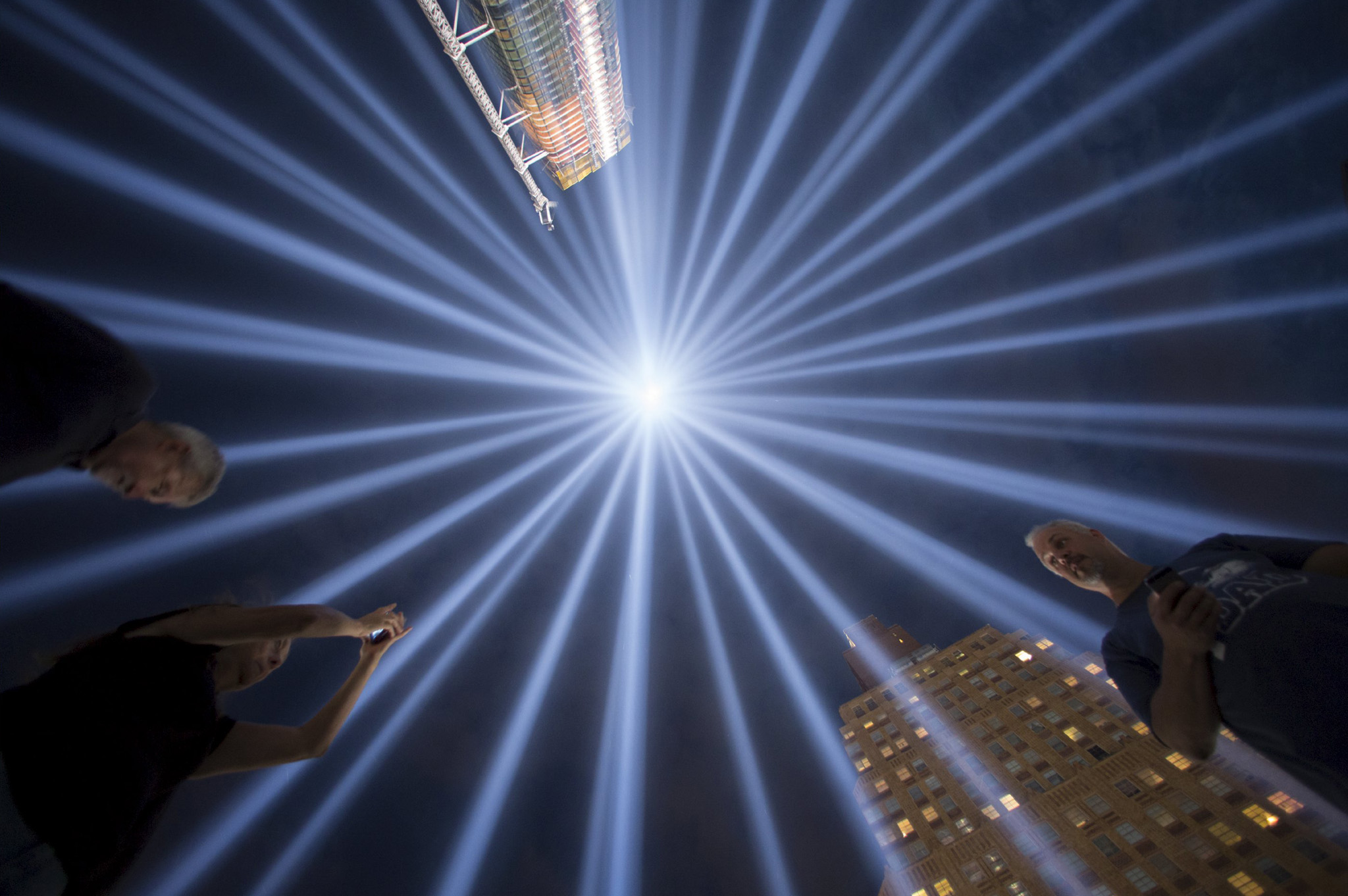 "People gather at the ""Tribute in Light"" in Lower Manhattan, New York...People gather at the ""Tribute in Light"" in Lower Manhattan, New York, September 9, 2015. The tribute was lit two days ahead of the 14th anniversary of the 9/11 terrorist attacks. REUTERS/Andrew Kelly      TPX IMAGES OF THE DAY"