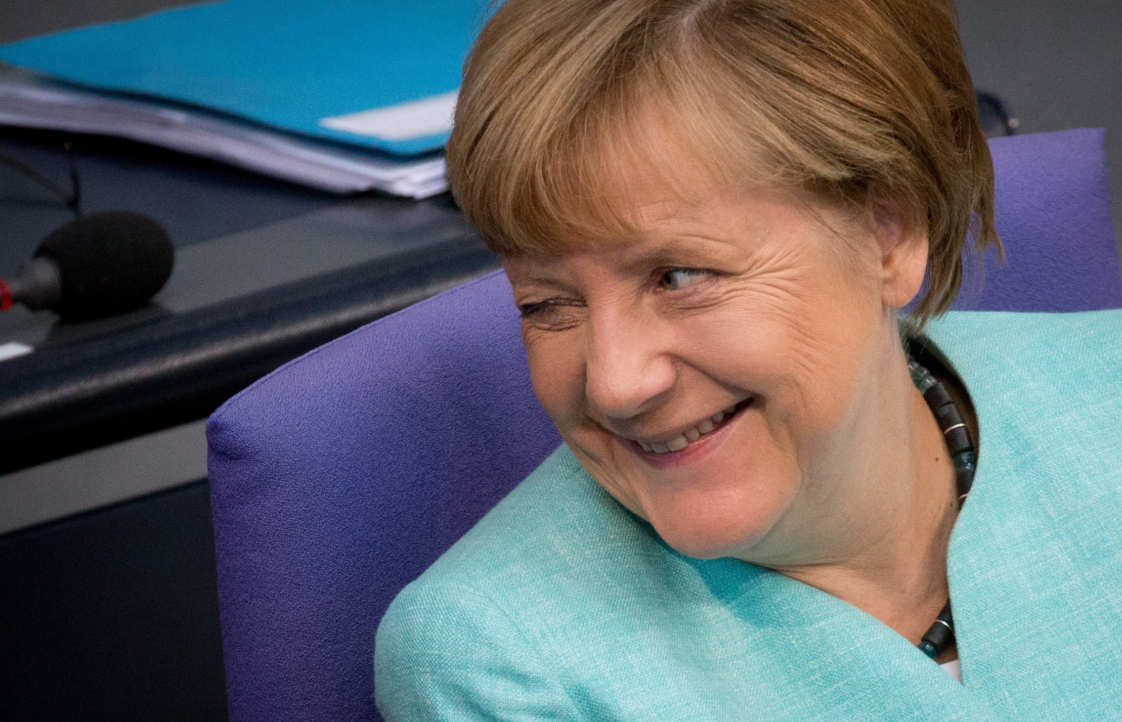 German Bundestag budget meeting...epa04923343 German Chancellor Angela Merkel winks at a colleague in the parliament building in Berlin, Germany, 10 September 2015. The German parliament continues to discuss the budget for 2016.  EPA/KAY NIETFELD