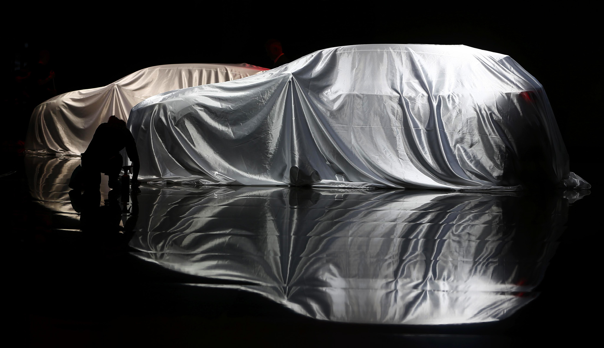 Veiled Infiniti cars are pictured during the media day at the Frankfurt Motor Show (IAA) in Frankfurt, Germany.