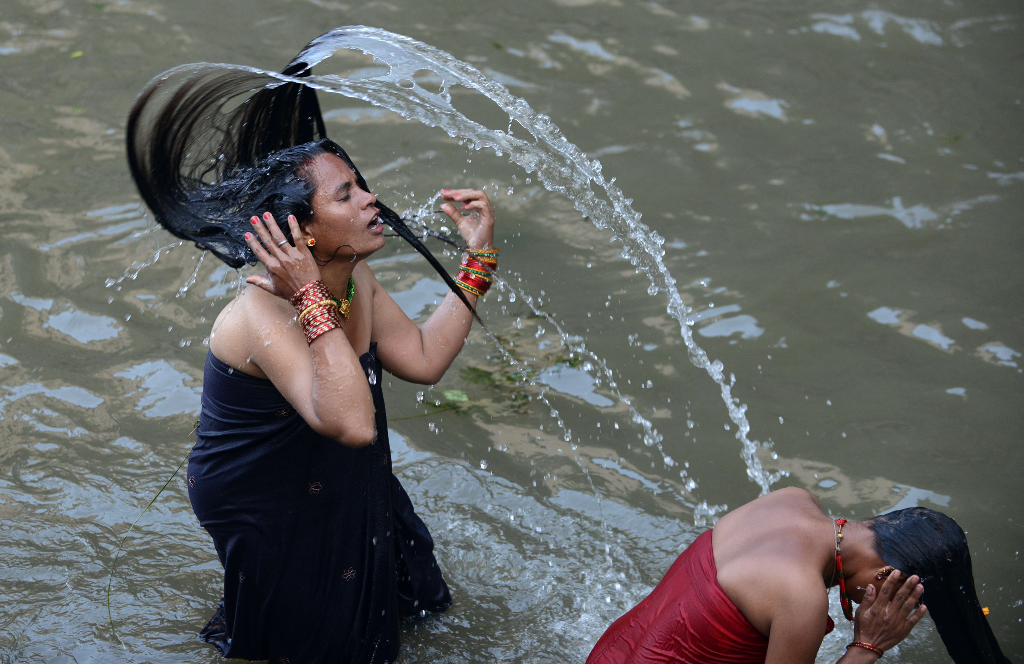 Nepalese Hindu women take a ritual bath in the Bagmati River during the Rishi Panchami festival in Kathmandu. Rishi Panchami marks the end of the three-day long Teej festival, in which married women fast and pray for the good health of their husbands to Shiva, the Hindu god of destruction, while unmarried women wish for handsome husbands and happy conjugal lives.