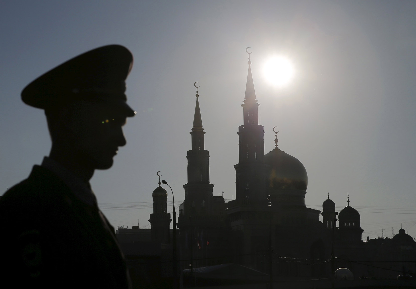 An Interior Ministry member stands guard near the Moscow Grand Mosque before an opening ceremony in Moscow