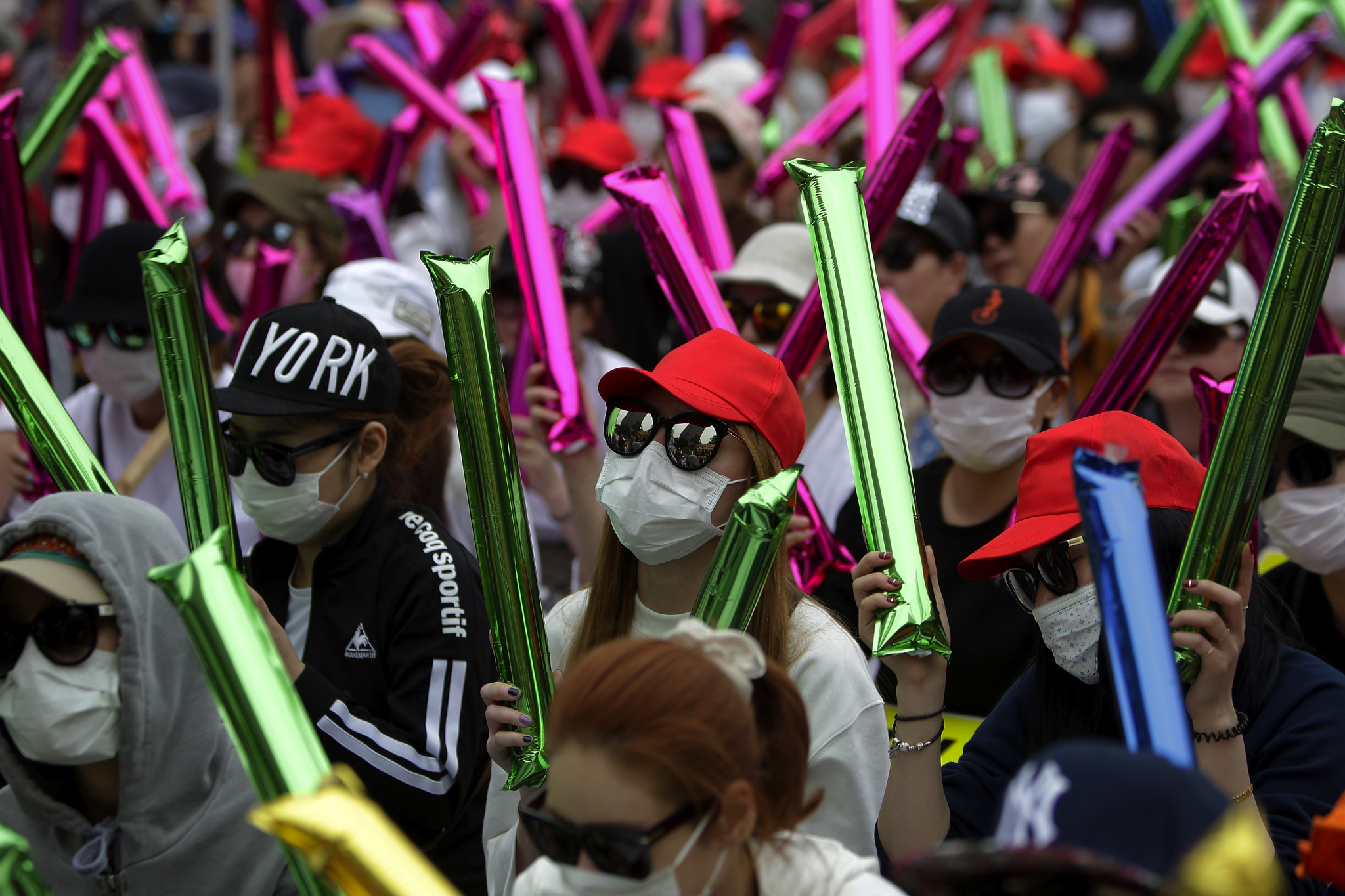 South Korean prostitutes hide their identities as they participate in a rally against anti-sex law in Seoul, South Korea. The government began enforcing new laws eleven years ago to target human traffickers, pimps and prostitutes.  Nearly seven years after tough laws began driving thousands of South Korean prostitutes out of business, sex workers of the red-light districts are fighting back, spurred by what they say is an unprecedented campaign of police harassment.