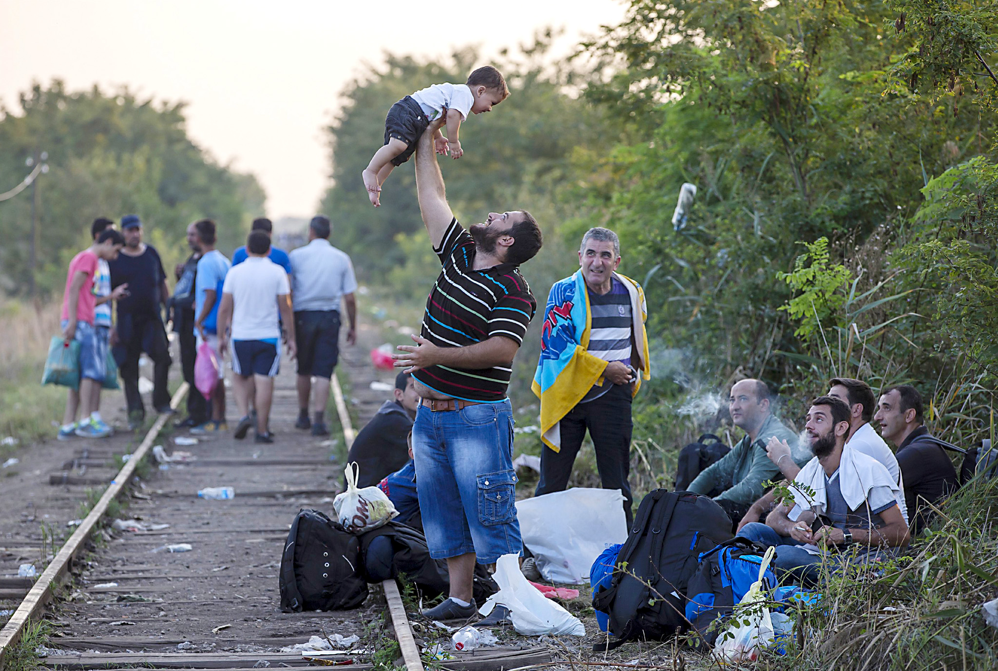 "ATTENTION EDITORS - REUTERS PICTURE HIGHLIGHT...ATTENTION EDITORS - REUTERS PICTURE HIGHLIGHTMDJ200A migrant, hoping to cross into Hungary, plays with a child along a railway track outside the village of Horgos in Serbia, towards the border it shares with Hungary, August 31, 2015.  REUTERS/Marko Djurica  TPX IMAGES OF THE DAYREUTERS NEWS PICTURES HAS NOW MADE IT EASIER TO FIND THE BEST PHOTOS FROM THE MOST IMPORTANT STORIES AND TOP STANDALONES EACH DAY. Search for ""TPX"" in the IPTC Supplemental Category field or ""IMAGES OF THE DAY"" in the Caption field and you will find a selection of 80-100 of our daily Top Pictures.REUTERS NEWS PICTURES."