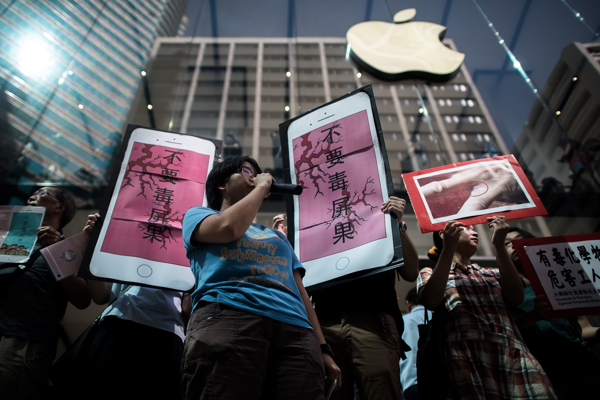 Rights campaigners stage a protest coinciding with the launch of the new iPhone 6s outside an Apple store in Hong Kong