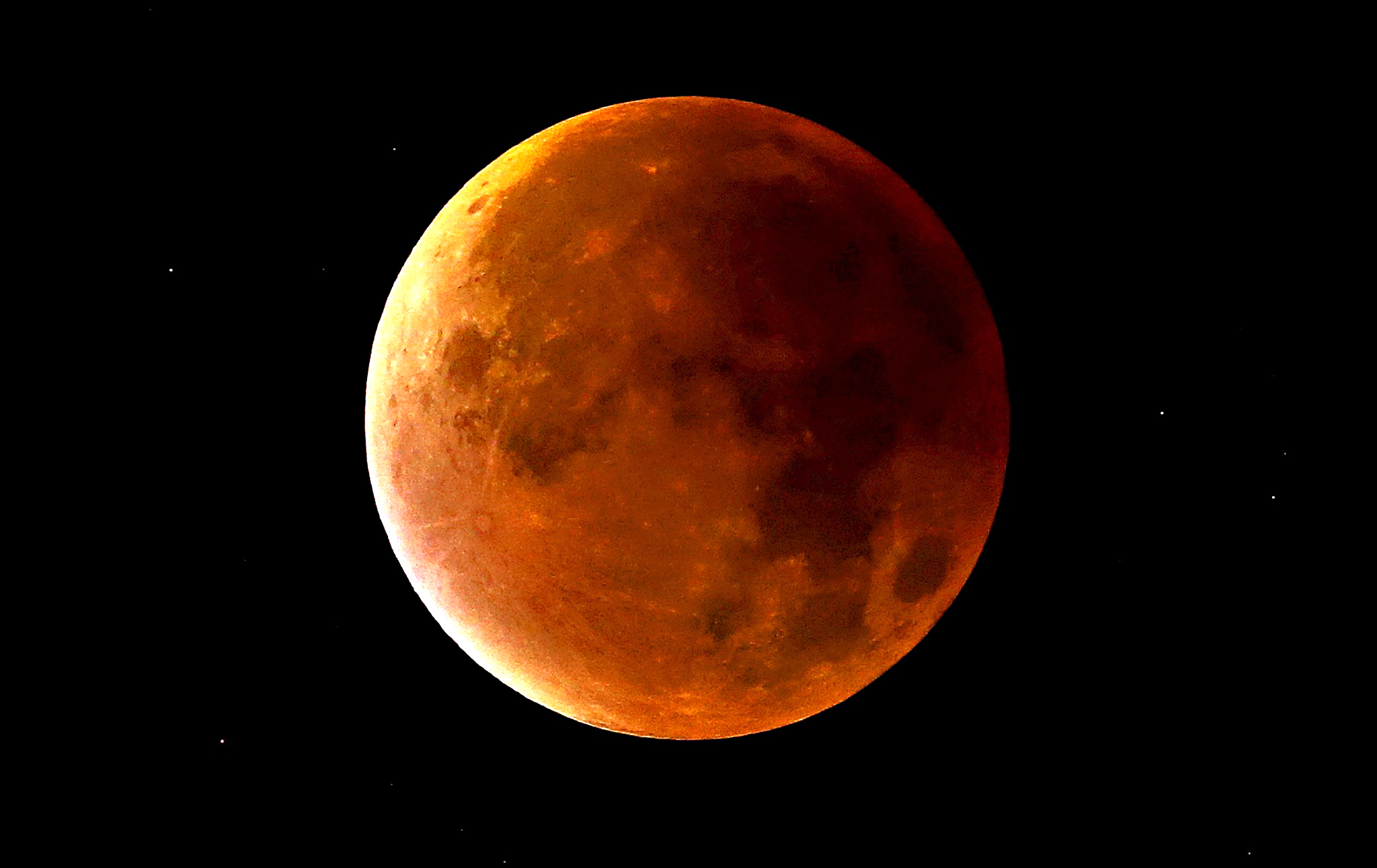 "A lunar eclipse coincides with a so-called ""supermoon"" in Newcastle-under-Lyme, Staffordshire, England. Sky-watchers around the world are in for a treat Sunday night and Monday when the shadow of Earth casts a reddish glow on the moon, the result of rare combination of an eclipse with the closest full moon of the year"