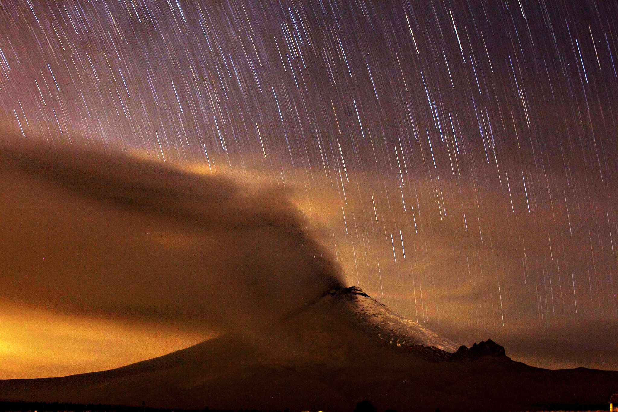 Volcano Cotopaxi seen from Alaquez, Ecuador. The volcano presented a new eruption of ashes that fell in the nearby towns