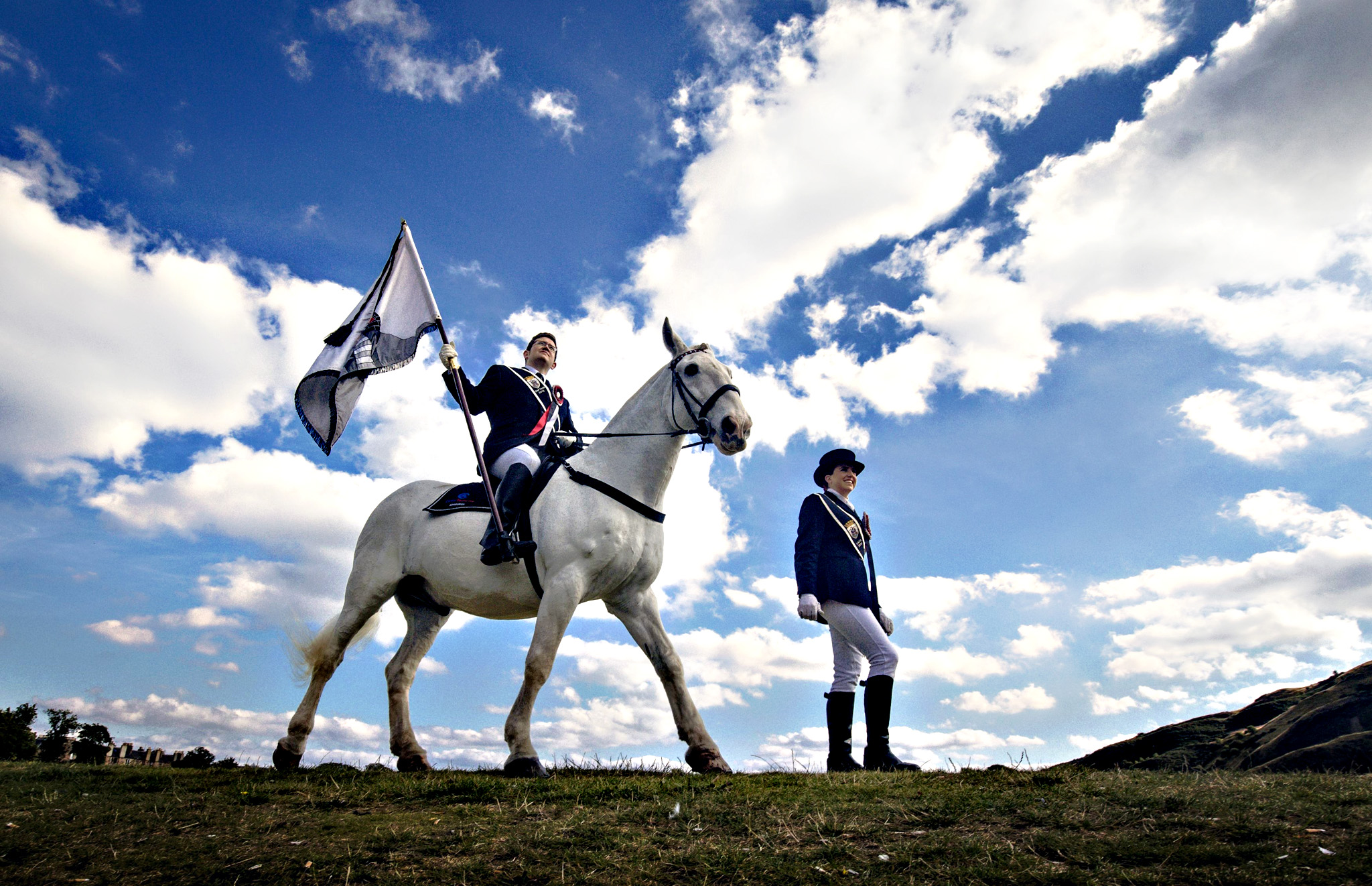 John Baxter riding Monarch the horse and Gemma Williamson during a photocall in Holyrood Park in Edinburgh ahead of the Edinburgh Riding of the Marches. PRESS ASSOCIATION Photo. Picture date: Thursday September 10, 2015. One of the largest rides in Scotland, and a spectacle of historical significance, the Edinburgh Riding of the Marches, expects to attract up to 20,000 spectators this weekend when 280 riders from Edinburgh and riding towns across the country gather together for a procession up the Royal Mile. The Riding of the Marches will take place on Sunday 13th September